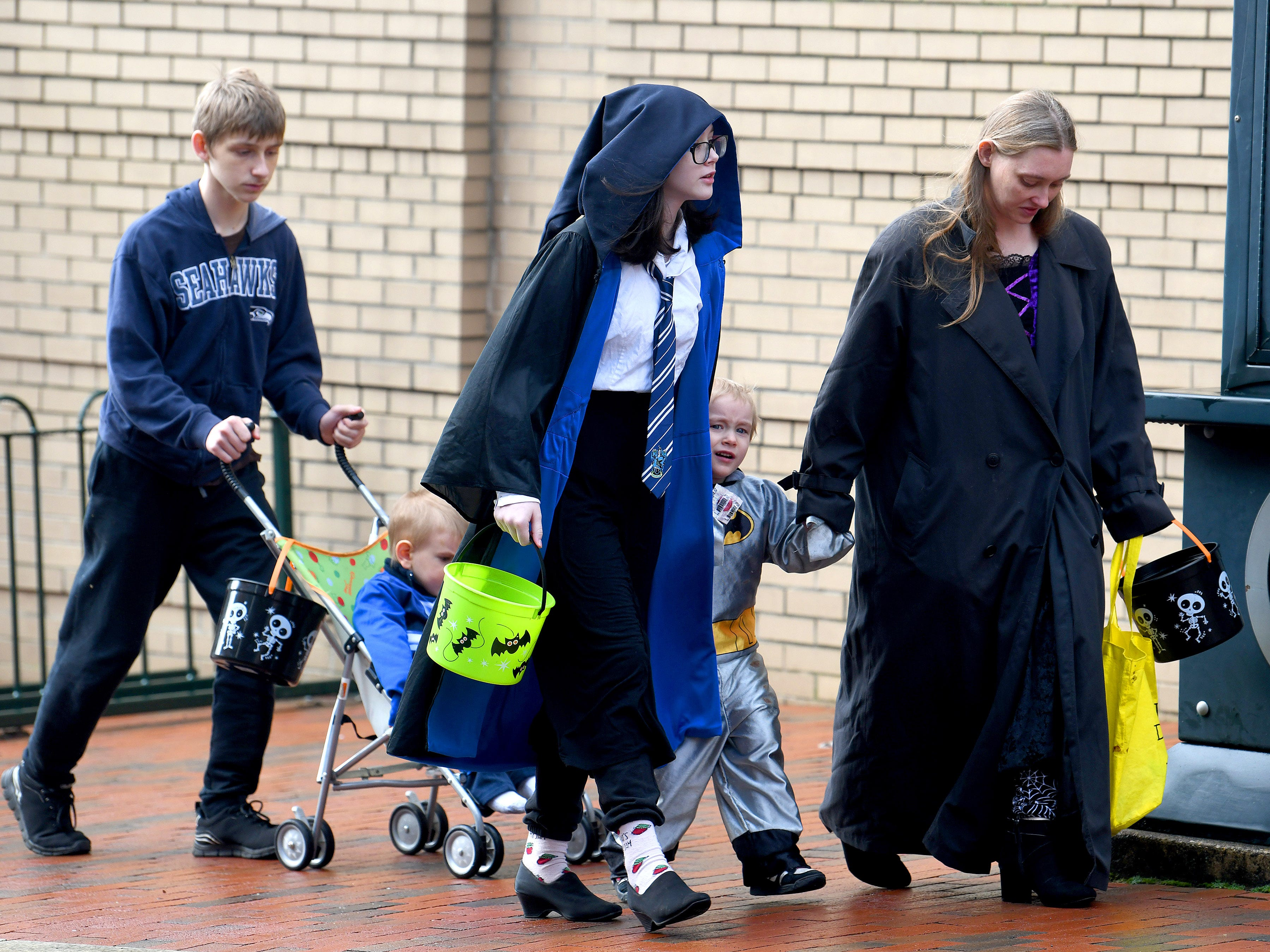 Trick-or-treaters of various ages arrive downtown for the annual downtown trick-or-treating event in Staunton on Saturday, Oct. 27, 2018.