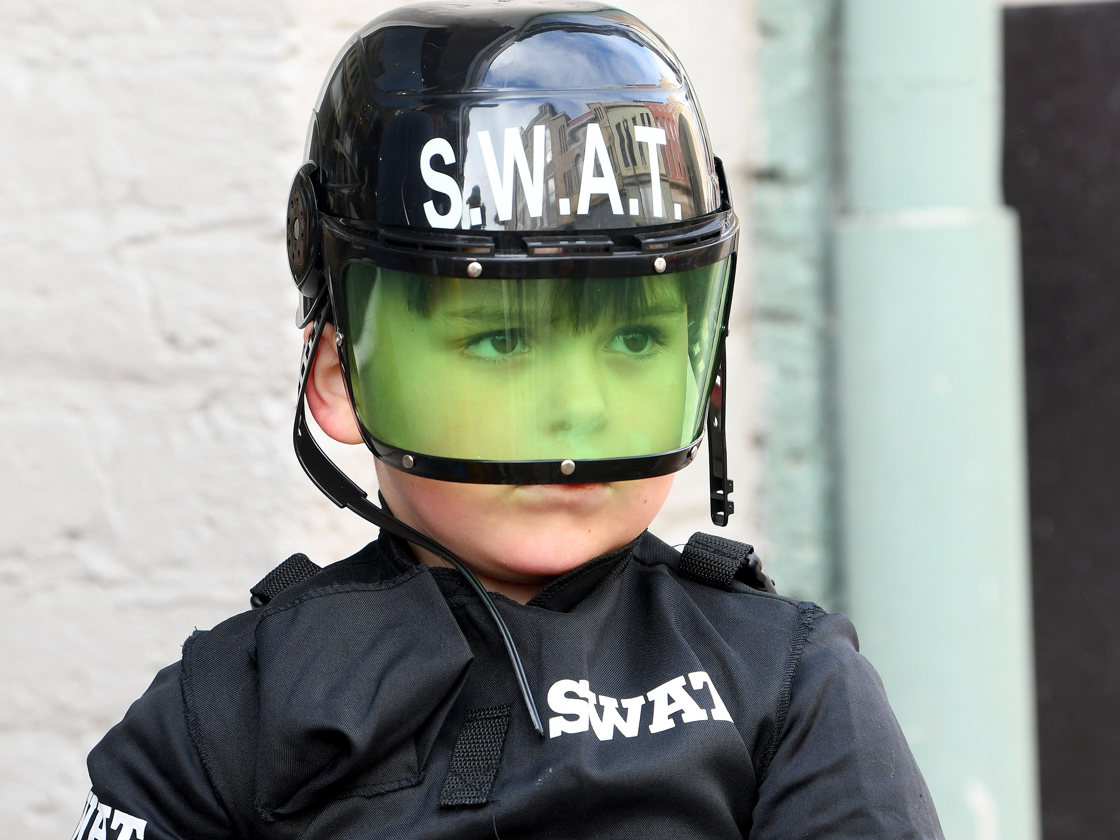 A young S.W.A.T. officer trick-or-treats in downtown Staunton on Saturday, Oct. 27, 2018.
