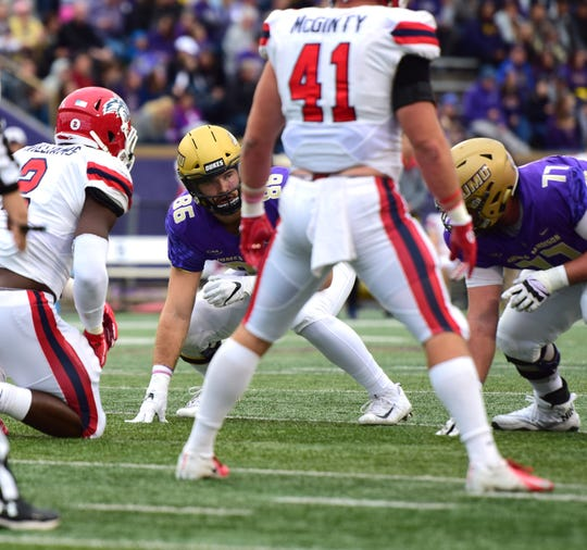 James Madison's Mack Cullen waits for the ball to be snapped for a play during the first half of the Dukes' Colonial Athletic Association football game against Stony Brook at Bridgeforth Stadium in Harrisonburg, Va., on Saturday, Oct. 27, 2018.