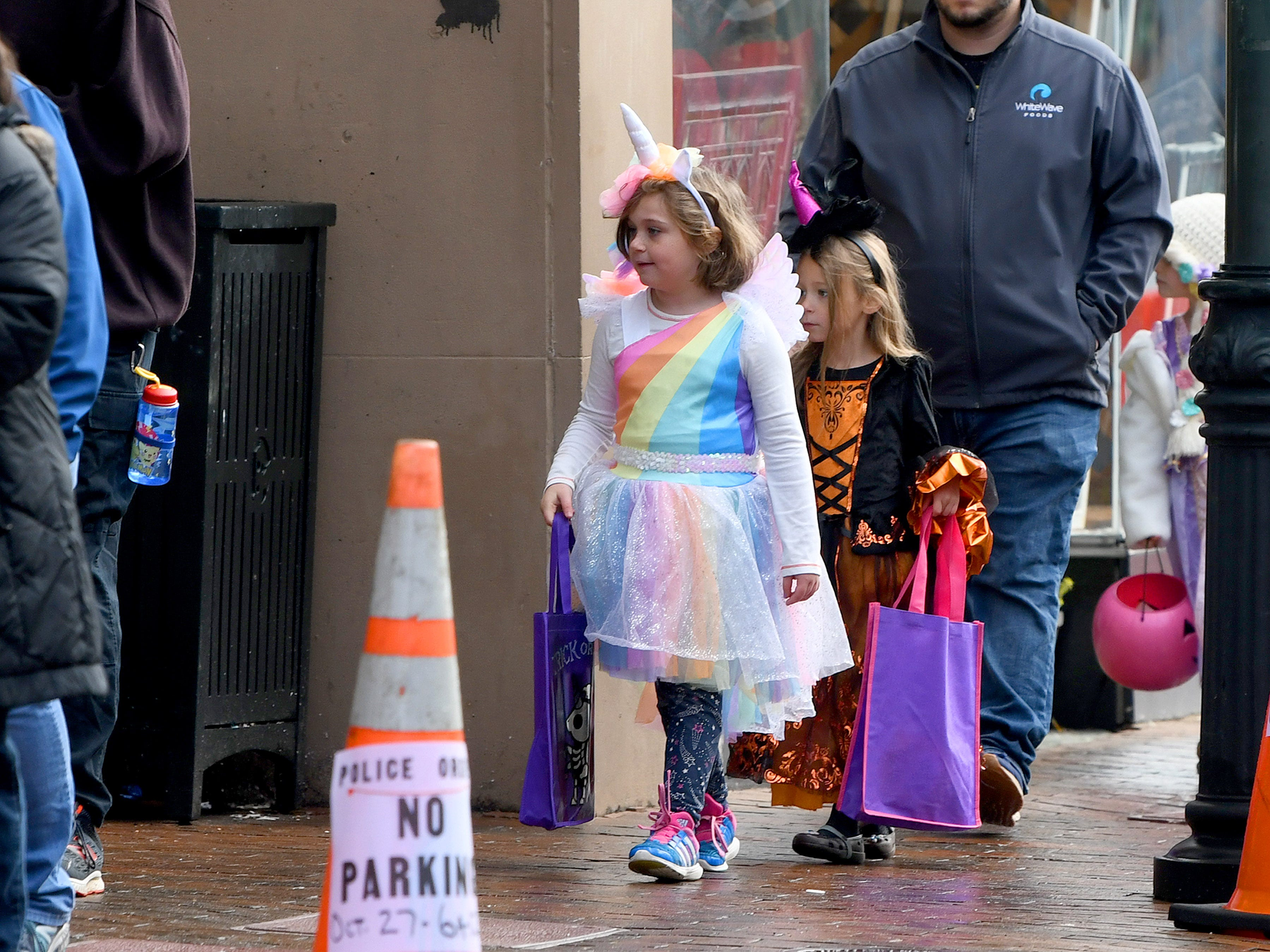 A unicorn trick-or-treats in downtown Staunton on Saturday, Oct. 27, 2018.