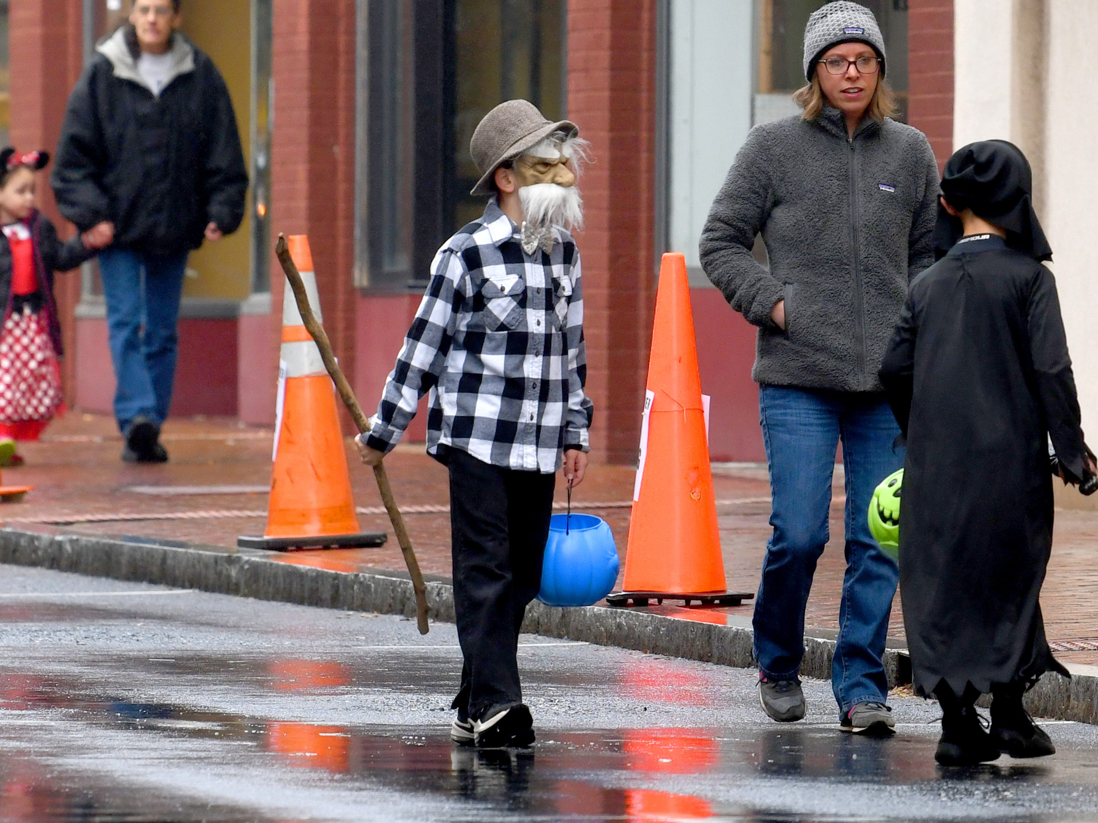 On trick-or-treater finds an old man the perfect costume while trick-or-treating in downtown Staunton on Saturday, Oct. 27, 2018.