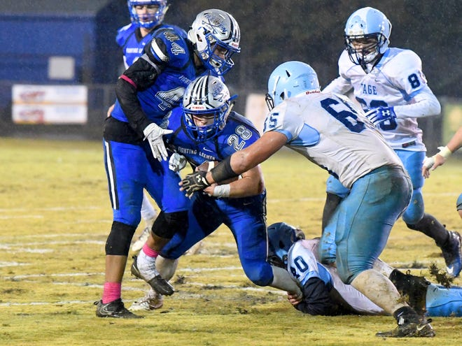 Robert E. Lee's Garrett Lawler struggles to keep going with the ball as a Page County player grabs him around the ankle during a game played in Staunton on Friday, Oct. 26. 2018.