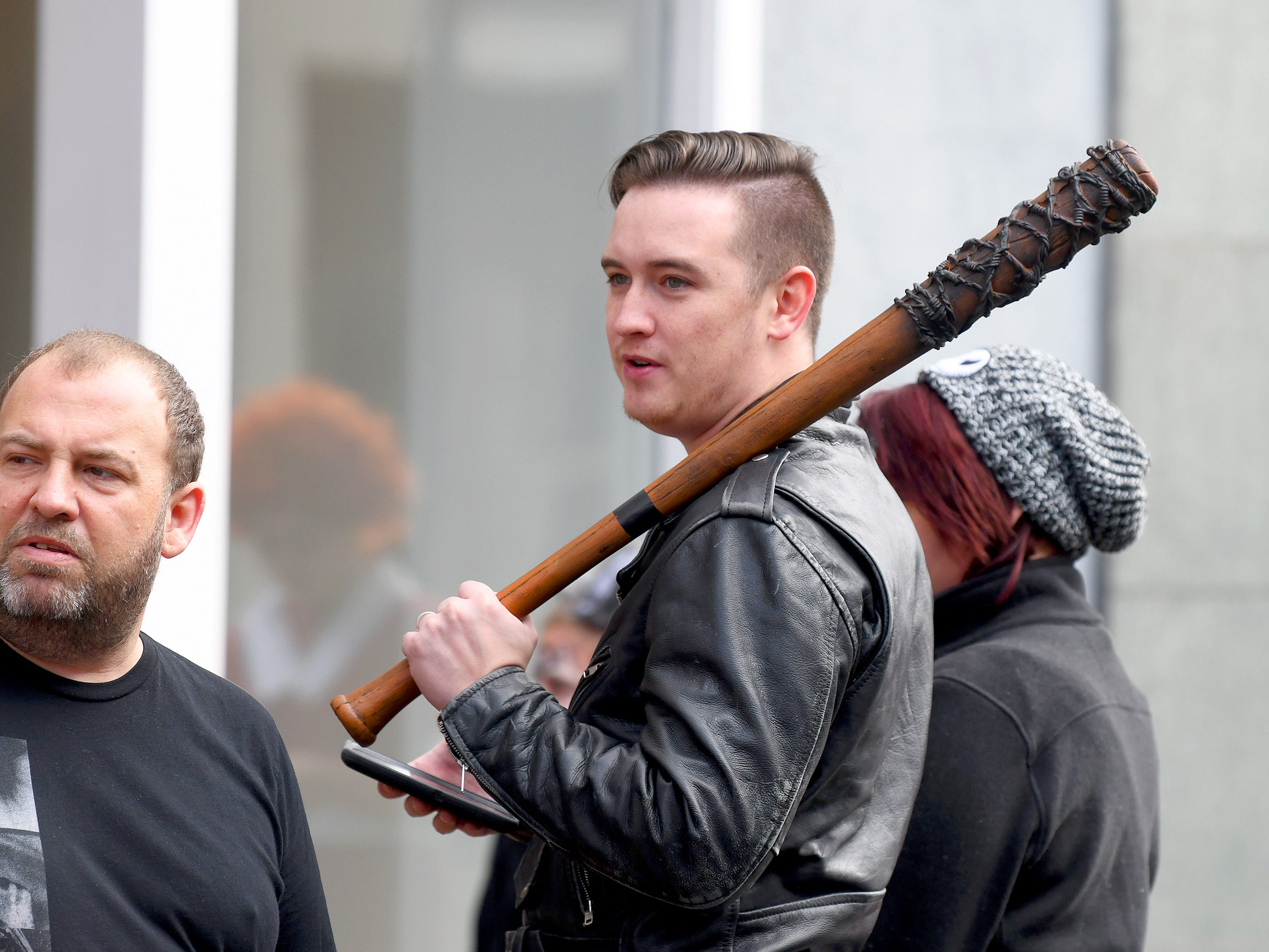 Kids aren't the only ones in costume. Negan from the Walking Dead holds his beloved baseball bat, Lucille, during the annual downtown trick-or-treating event in Staunton on Saturday, Oct. 27, 2018.