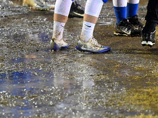 A Robert E. Lee player stands on a wet and muddy sideline during a game played in Staunton on Friday, Oct. 26. 2018.