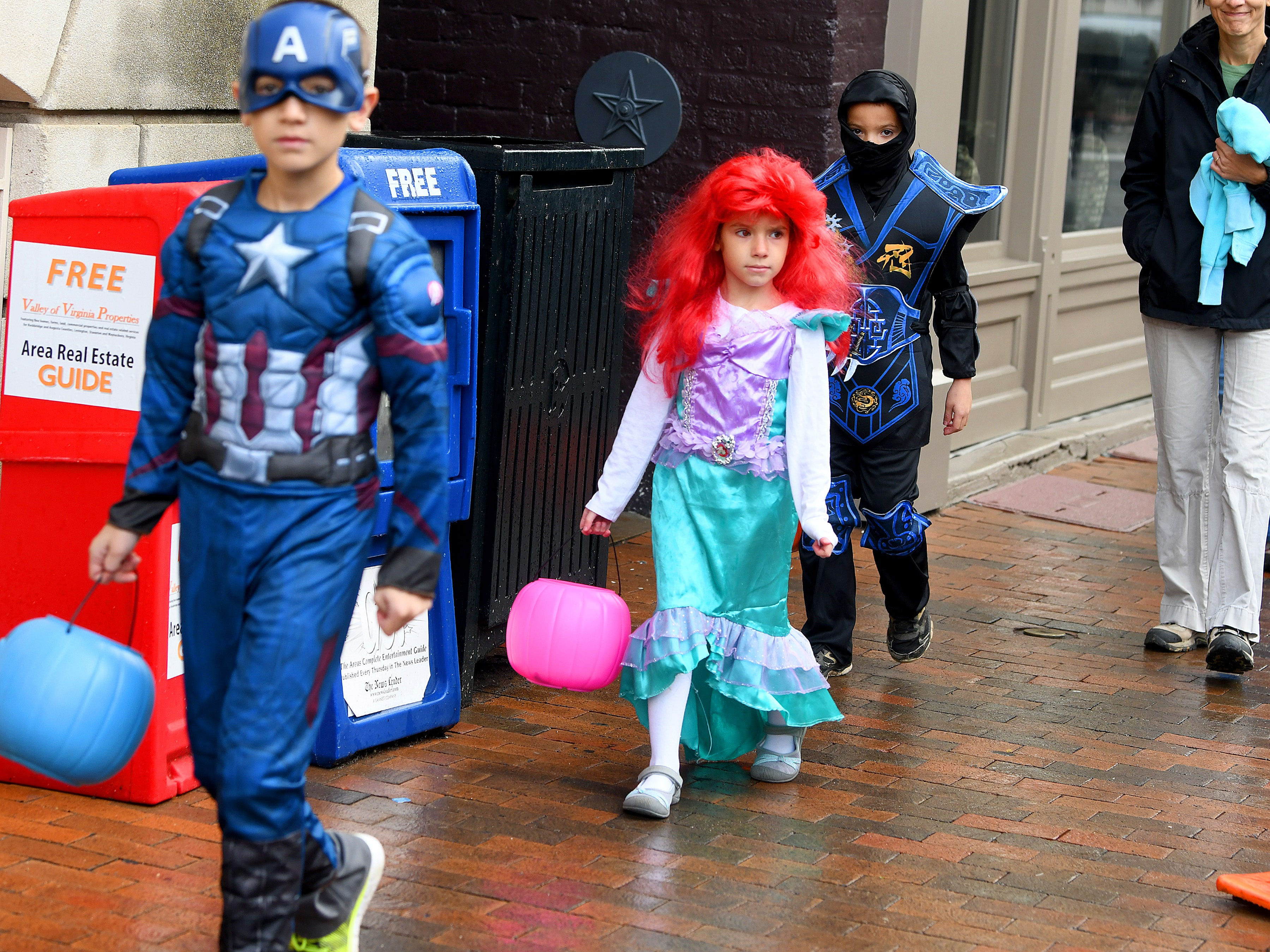 A Disney princess trick-or-treats in downtown Staunton on Saturday, Oct. 27, 2018.