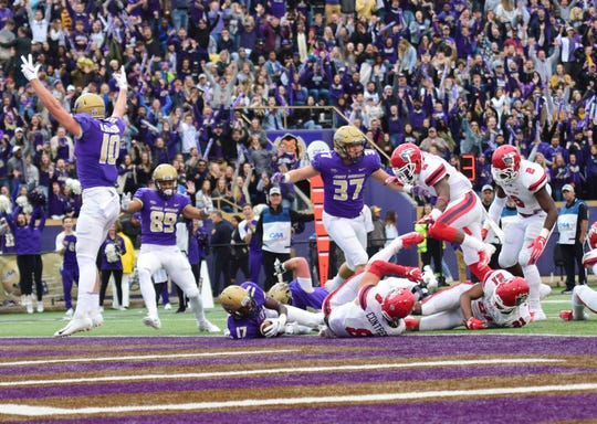 James Madison's Kyndel Dean gets into the end zone for a first-half touchdown during the Dukes' Colonial Athletic Association football game against Stony Brook at Bridgeforth Stadium in Harrisonburg, Va., on Saturday, Oct. 27, 2018.