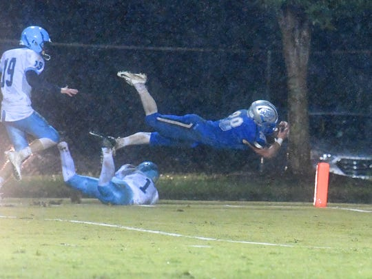 Robert E. Lee's Garrett Lawler dives overtop Page County's Trevor Williams and into the end zone for a touchdown during a game played in Staunton on Friday, Oct. 26. 2018.