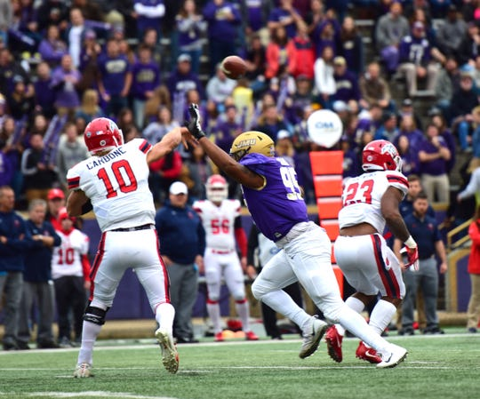 James Madison's Adeeb Atariwa pressures Stony Brook quarterback Joe Carbone during the ifrst half of their Colonial Athletic Association football game at Bridgeforth Stadium in Harrisonburg, Va., on Saturday, Oct. 27, 2018.