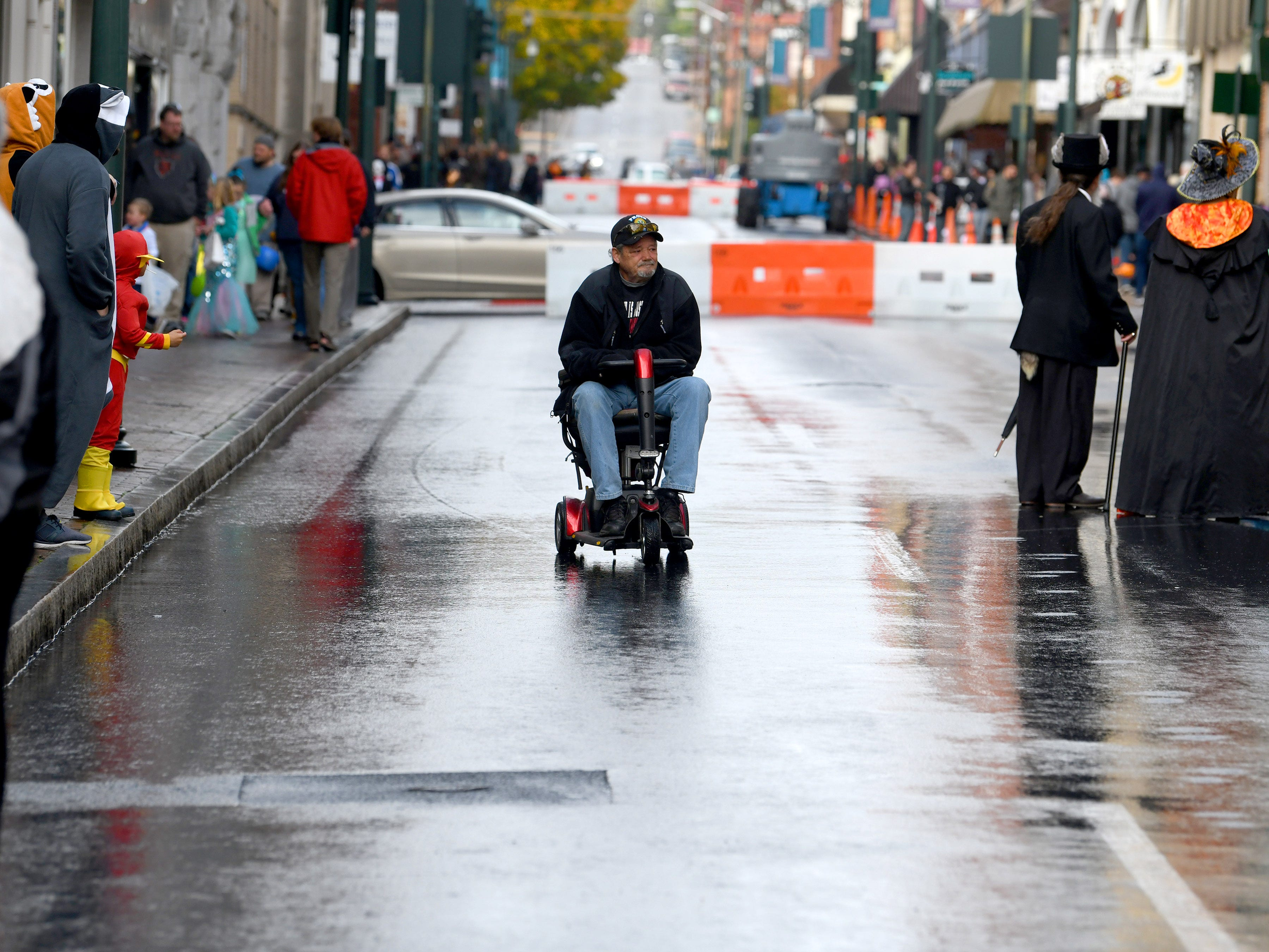 A man on a scooter takes advantage of the closed streets during the annual downtown trick-or-treating event in Staunton on Saturday, Oct. 27, 2018.