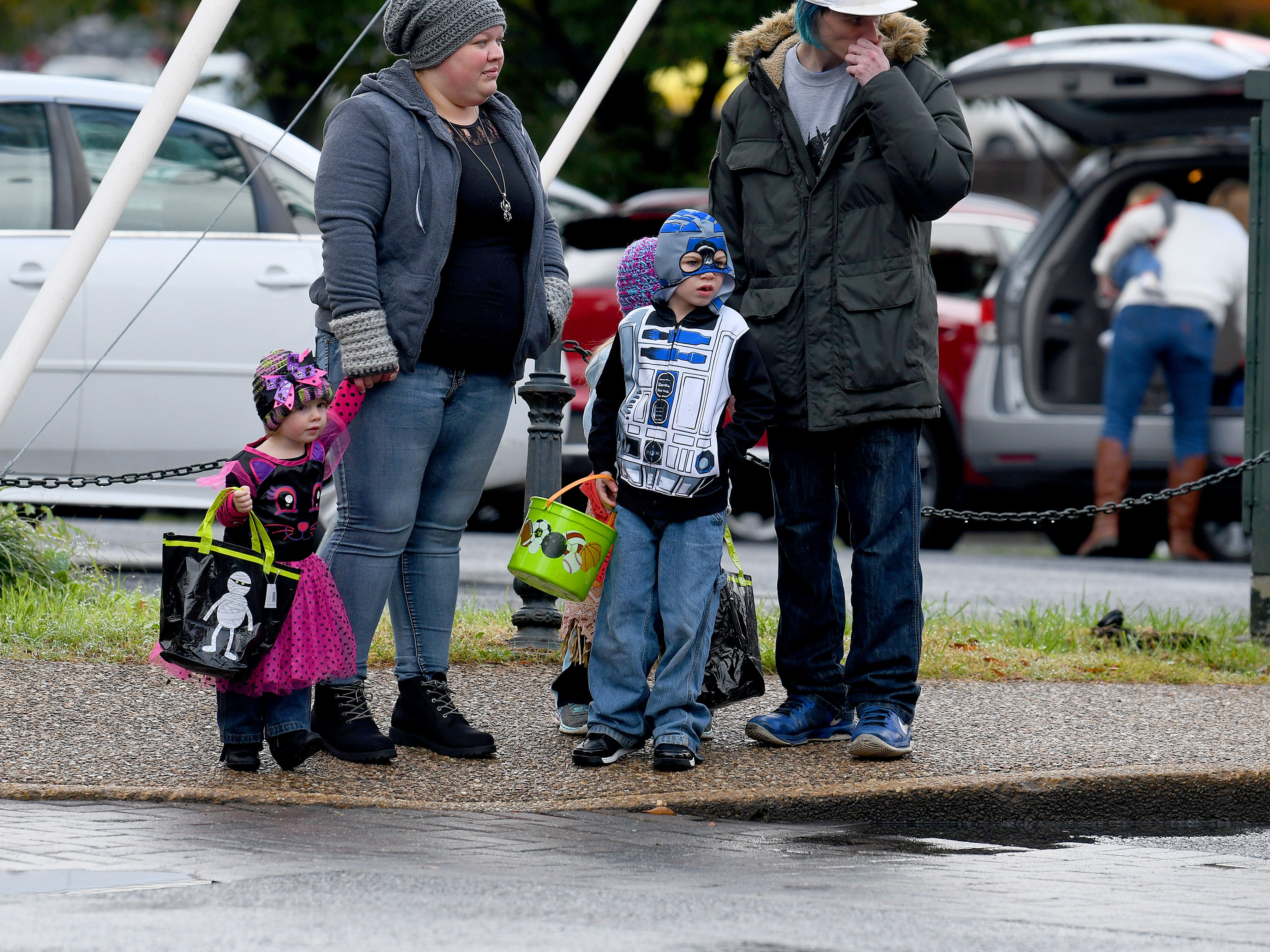 R2D2 waits to cross Johnson Street with family while trick-or-treating in downtown Staunton on Saturday, Oct. 27, 2018.
