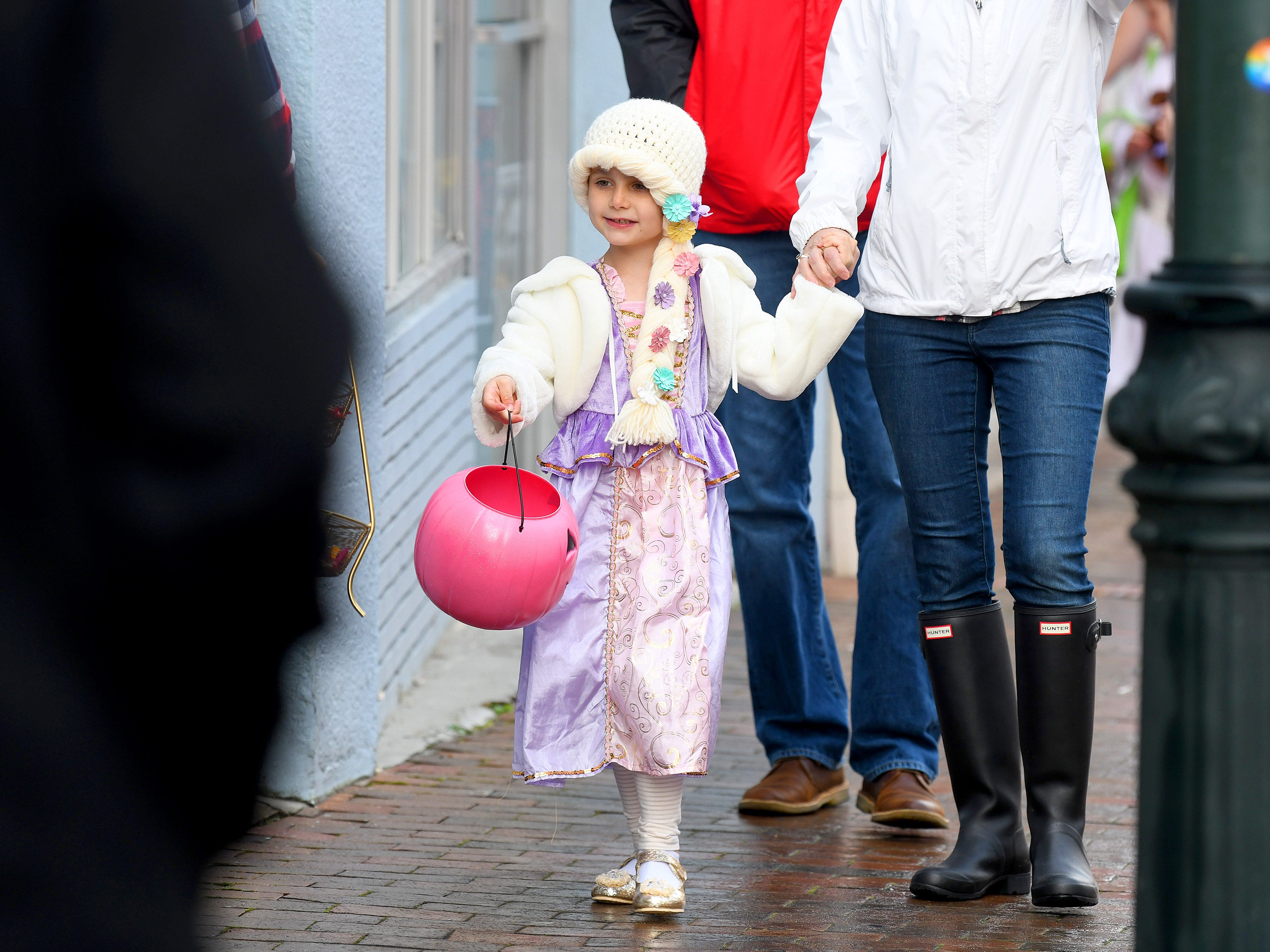 A young princess trick-or-treats in downtown Staunton on Saturday, Oct. 27, 2018.