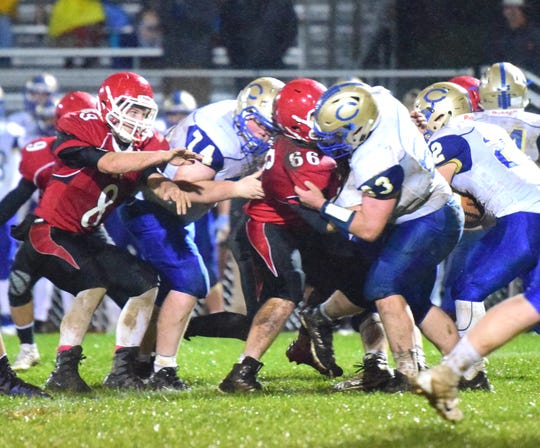Riverheads' defense battles with Central-Woodstock's offensive line during the first quarter of their nondistrict football game on Friday, Oct. 26, 2018, at Riverheads High School in Greenville, Va.