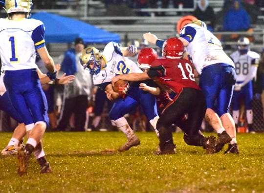 Riverheads' Justin McWhorter tries the strip the ball out of the grasp of Central-Woodstock's Shane Watson during the first quarter of their nondistrict football game on Friday, Oct. 26, 2018, at Riverheads High School in Greenville, Va.