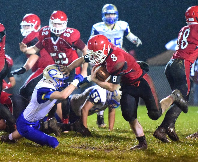 Riverheads' Zac Smiley stiff-arms Central-Woodstock's Kyle Clanton on his way to a 68-yard touchdown run in the second quarter of their nondistrict football game on Friday, Oct. 26, 2018, at Riverheads High School in Greenville, Va.