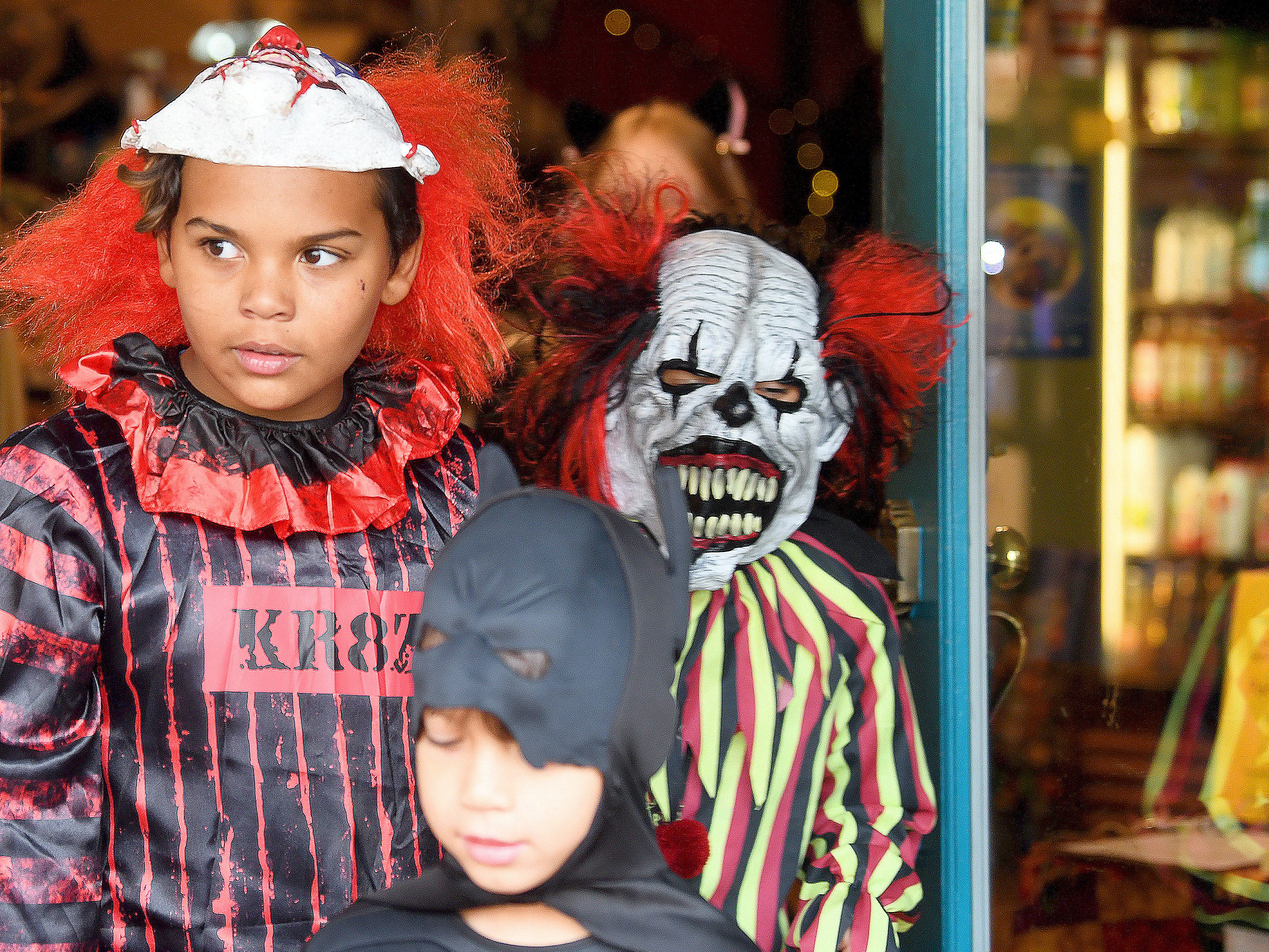 """""""Crazy"""" clowns trick-or-treat together in downtown Staunton on Saturday, Oct. 27, 2018."""