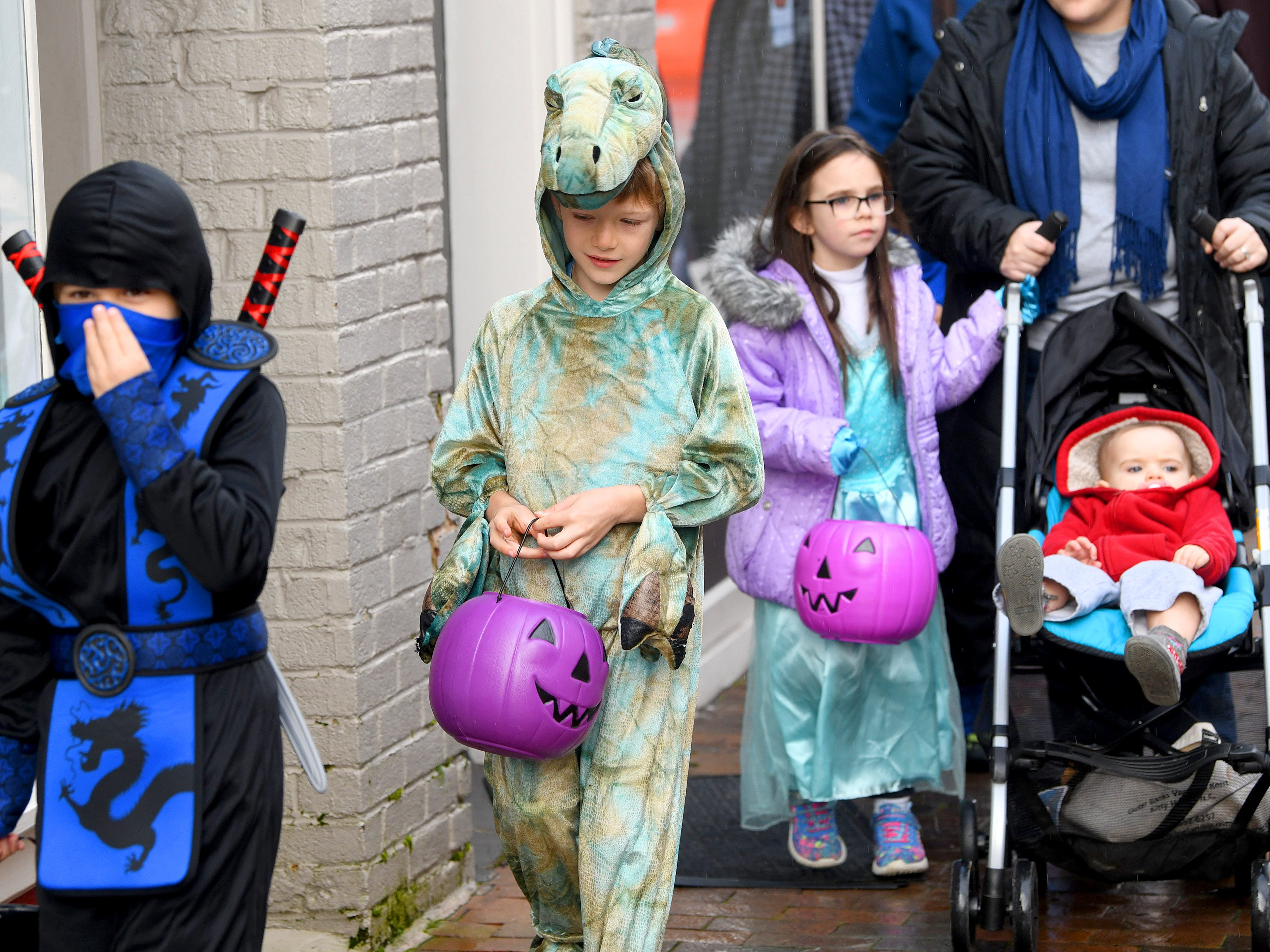 Young trick-or-treaters on a quest for treats during the annual downtown trick-or-treating event in Staunton on Saturday, Oct. 27, 2018.