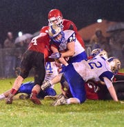 Riverheads' Blake Smith stops Central-Woodstock's Shane Watson after a short gain during their nondistrict football game on Friday, Oct. 26, 2018, at Riverheads High School in Greenville, Va.