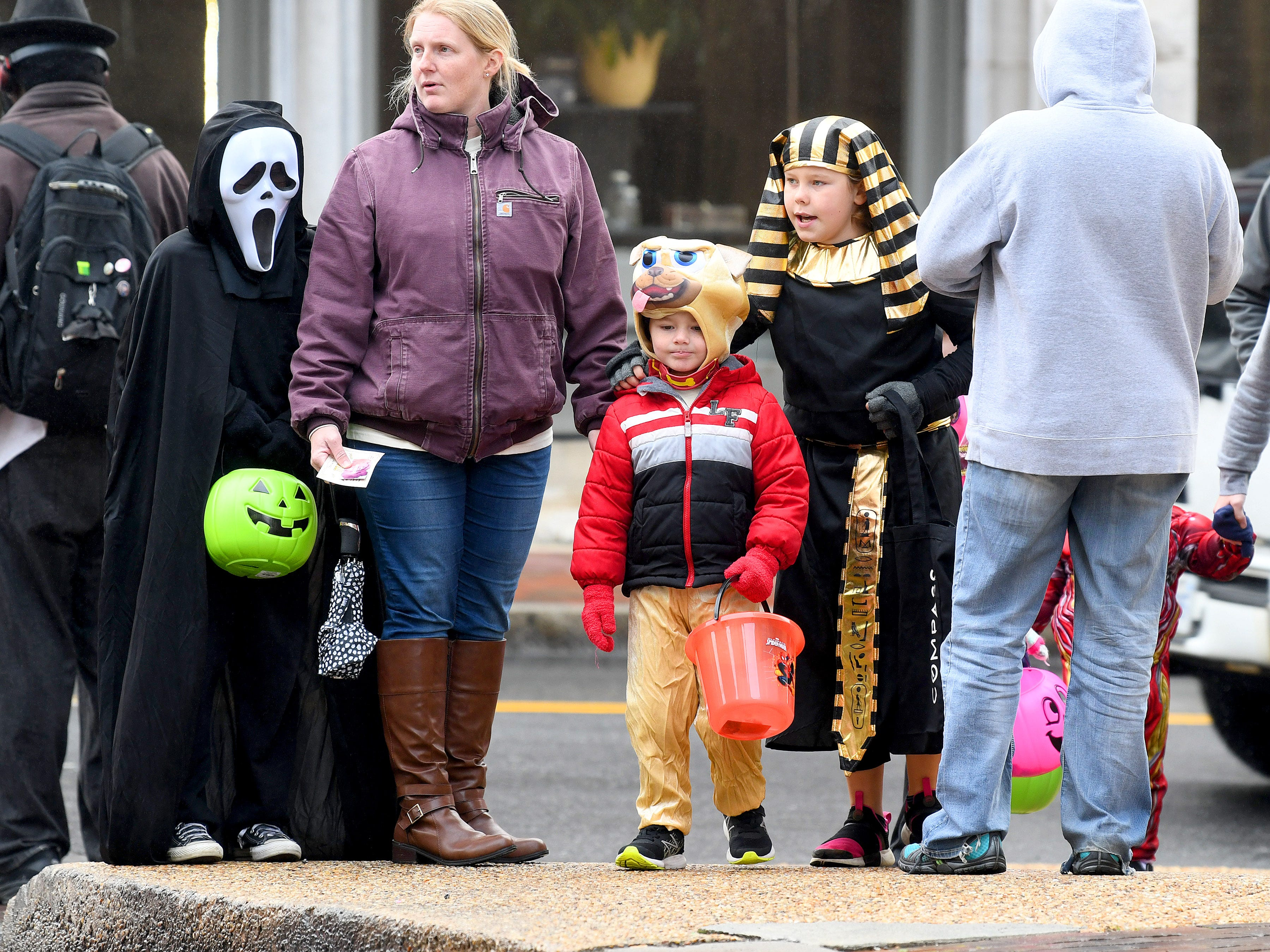 Ghostface, a canine and a pharaoh trick-or treat together during the annual downtown trick-or-treating event in Staunton on Saturday, Oct. 27, 2018.