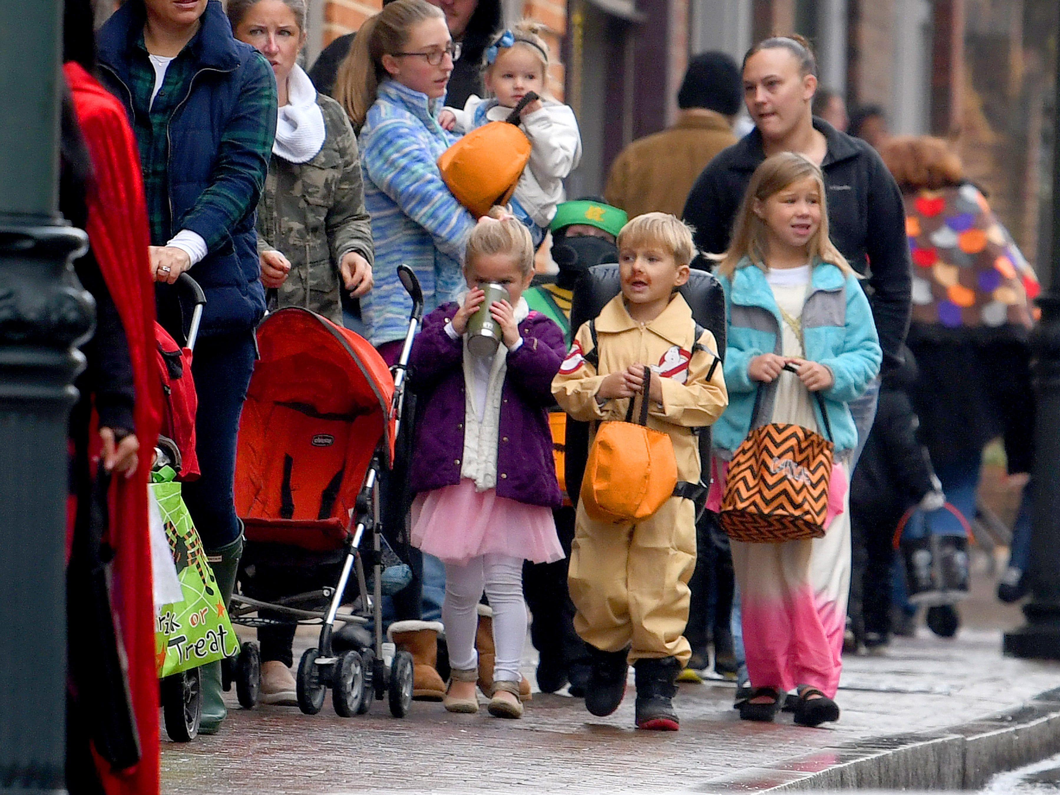 Trick-or-treaters filled a sidewalk while trick-or-treating in downtown Staunton on Saturday, Oct. 27, 2018.