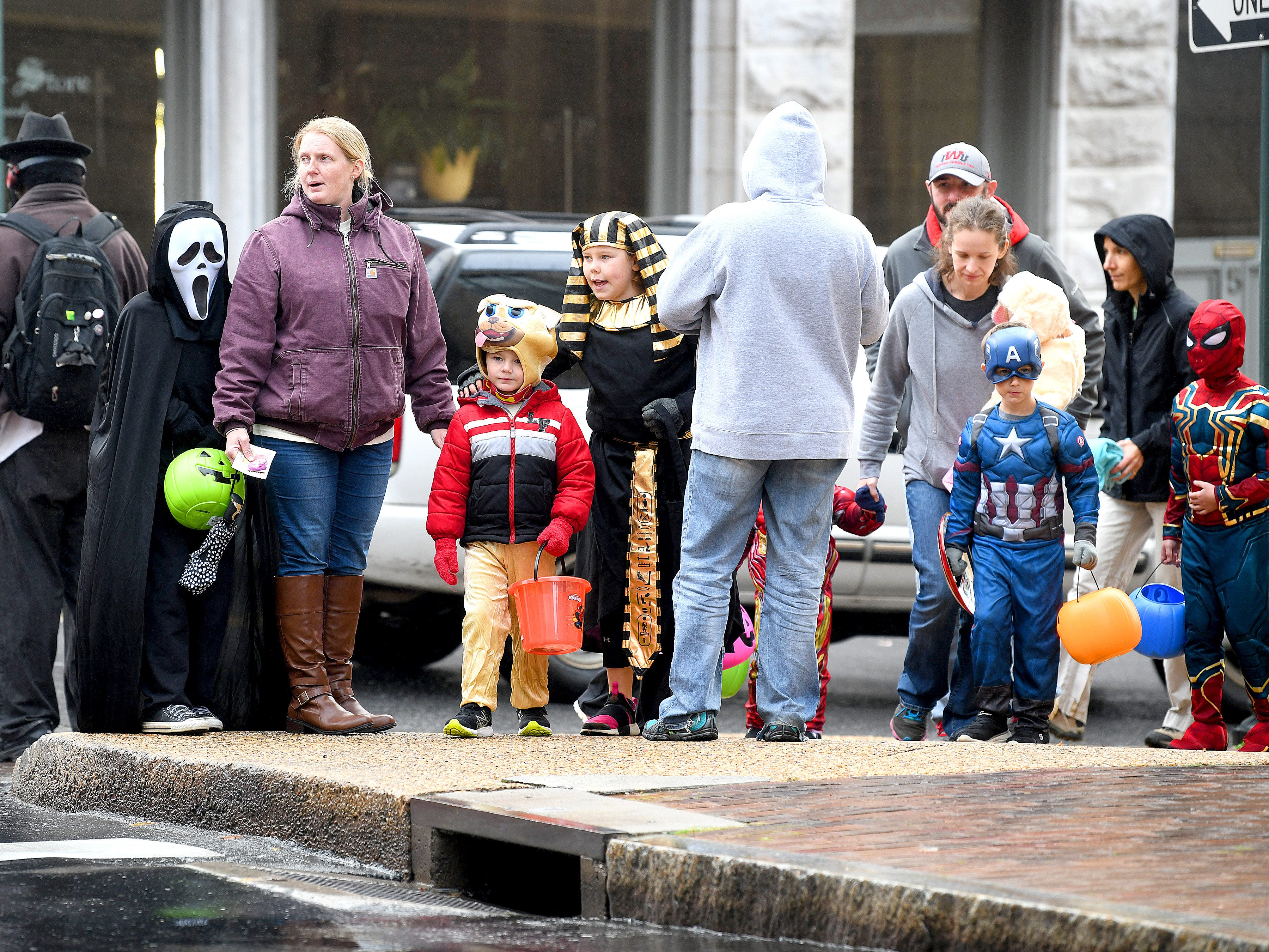 Trick-or-treaters fill a street corner while trick-or-treating in downtown Staunton on Saturday, Oct. 27, 2018.
