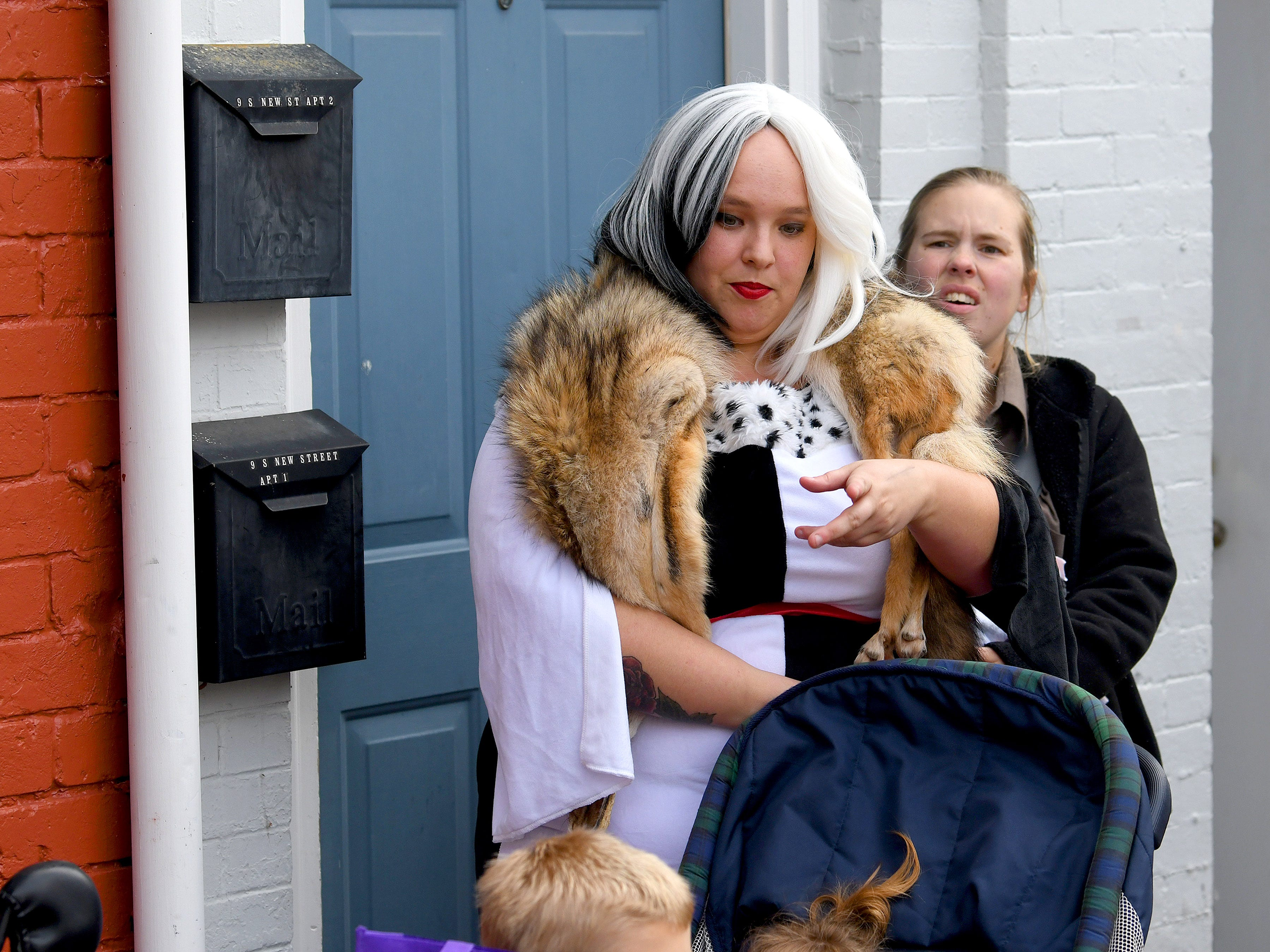 One adult dresses as Cruella DeVille during the annual downtown trick-or-treating event in Staunton on Saturday, Oct. 27, 2018.
