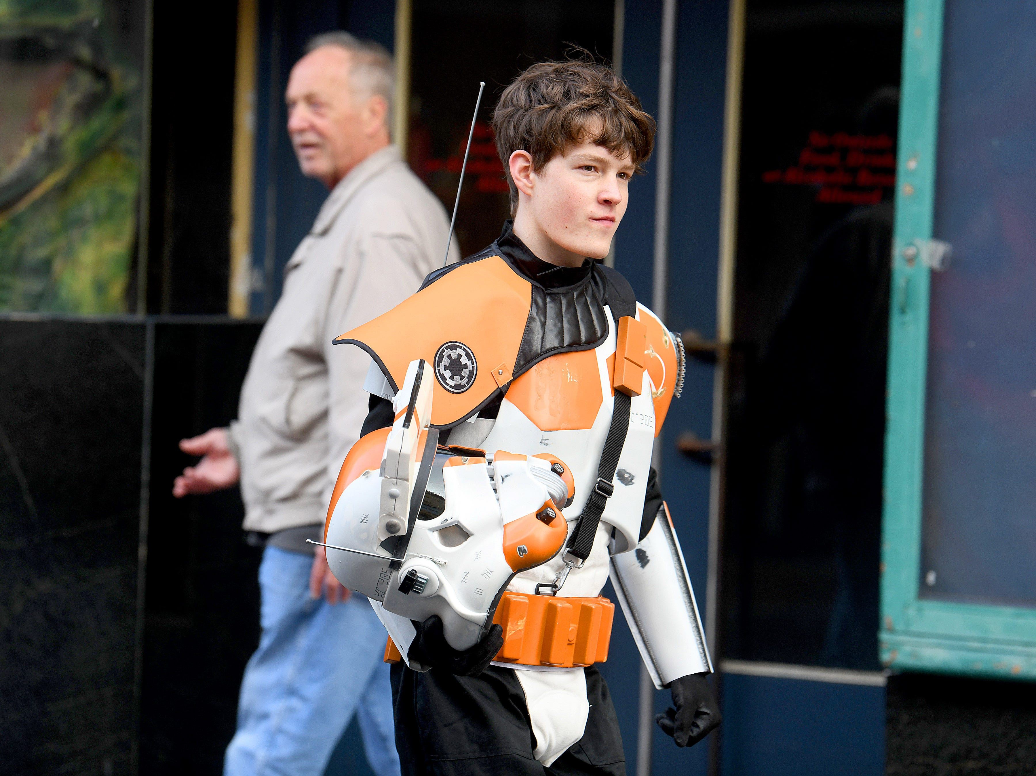 A young Stormtrooper walks the street during the annual downtown trick-or-treating event in Staunton on Saturday, Oct. 27, 2018.