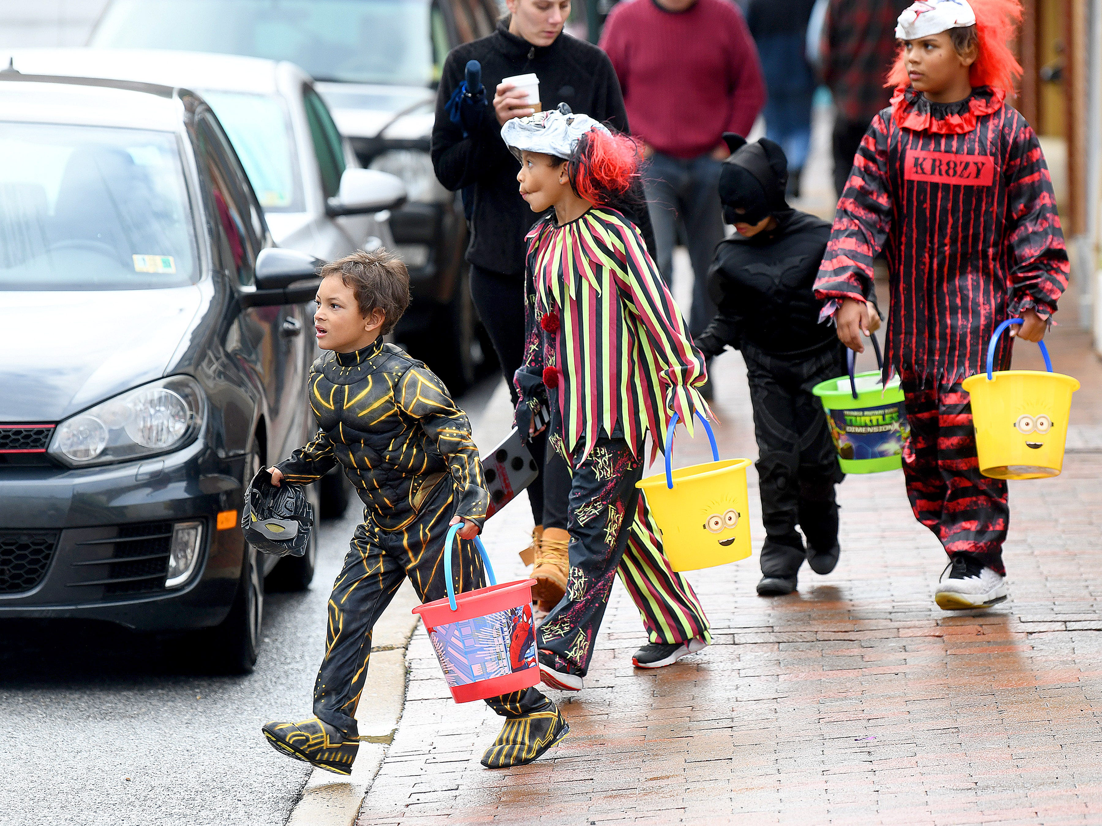 """Crazy"" clowns and superheroes mix together while trick-or-treating in downtown Staunton on Saturday, Oct. 27, 2018."