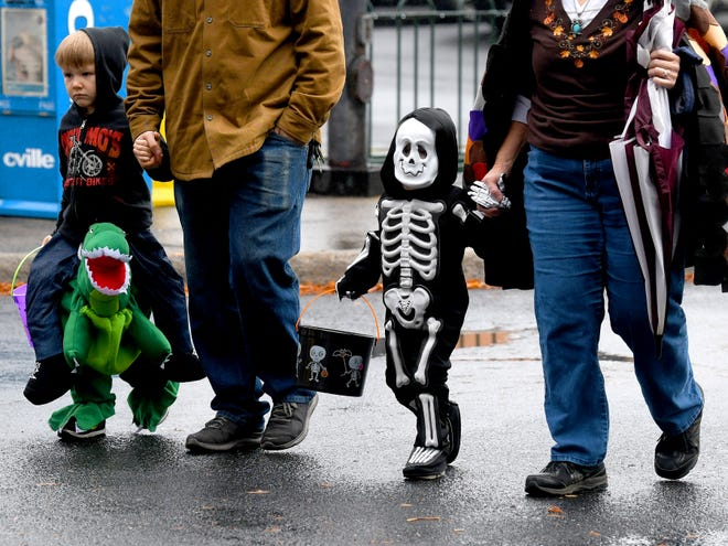 A skeleton trick-or-treats in downtown Staunton on Saturday, Oct. 27, 2018.