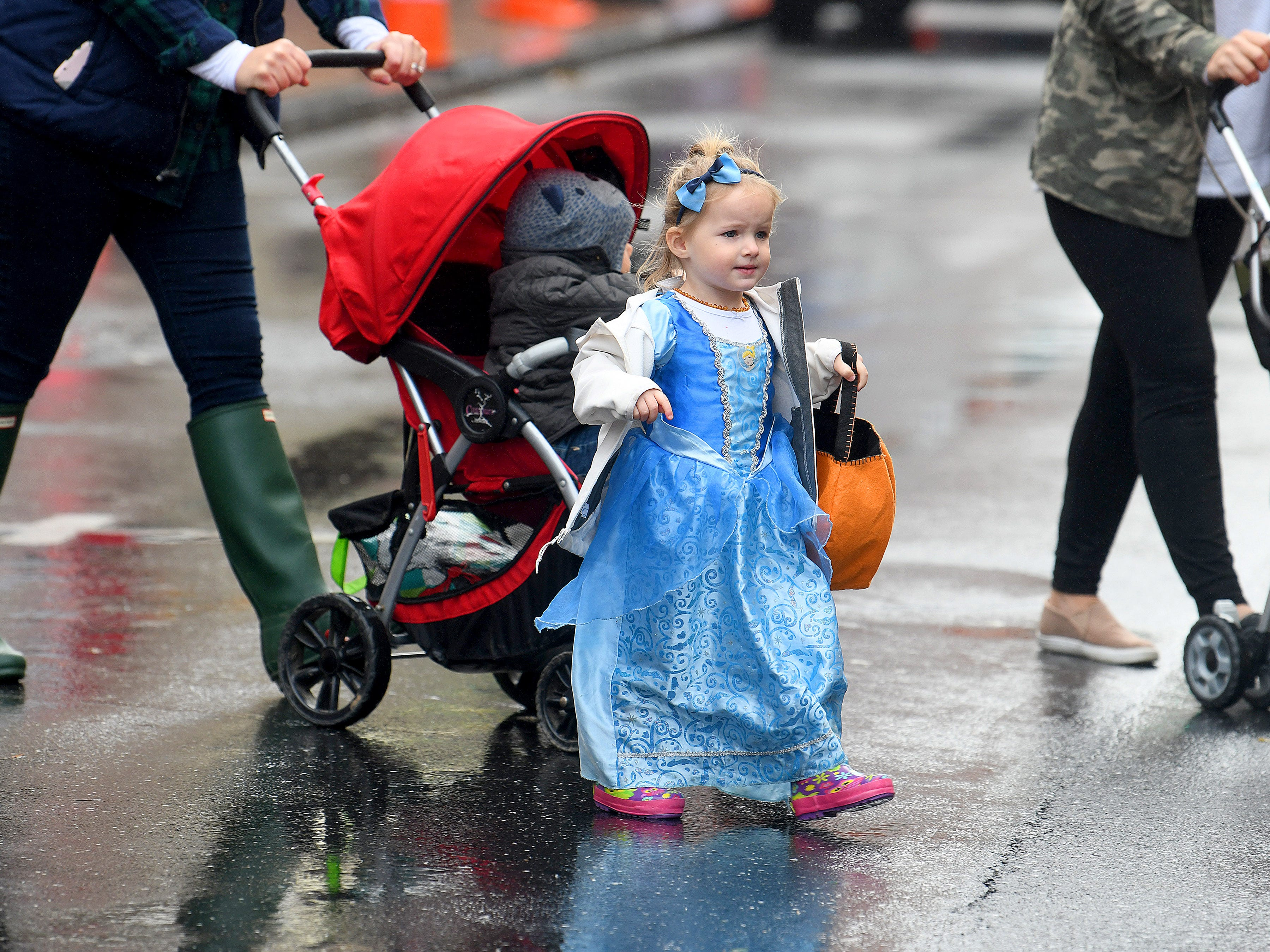 A young princess crosses the street for the candy on the opposite side while trick-or-treating in downtown Staunton on Saturday, Oct. 27, 2018.