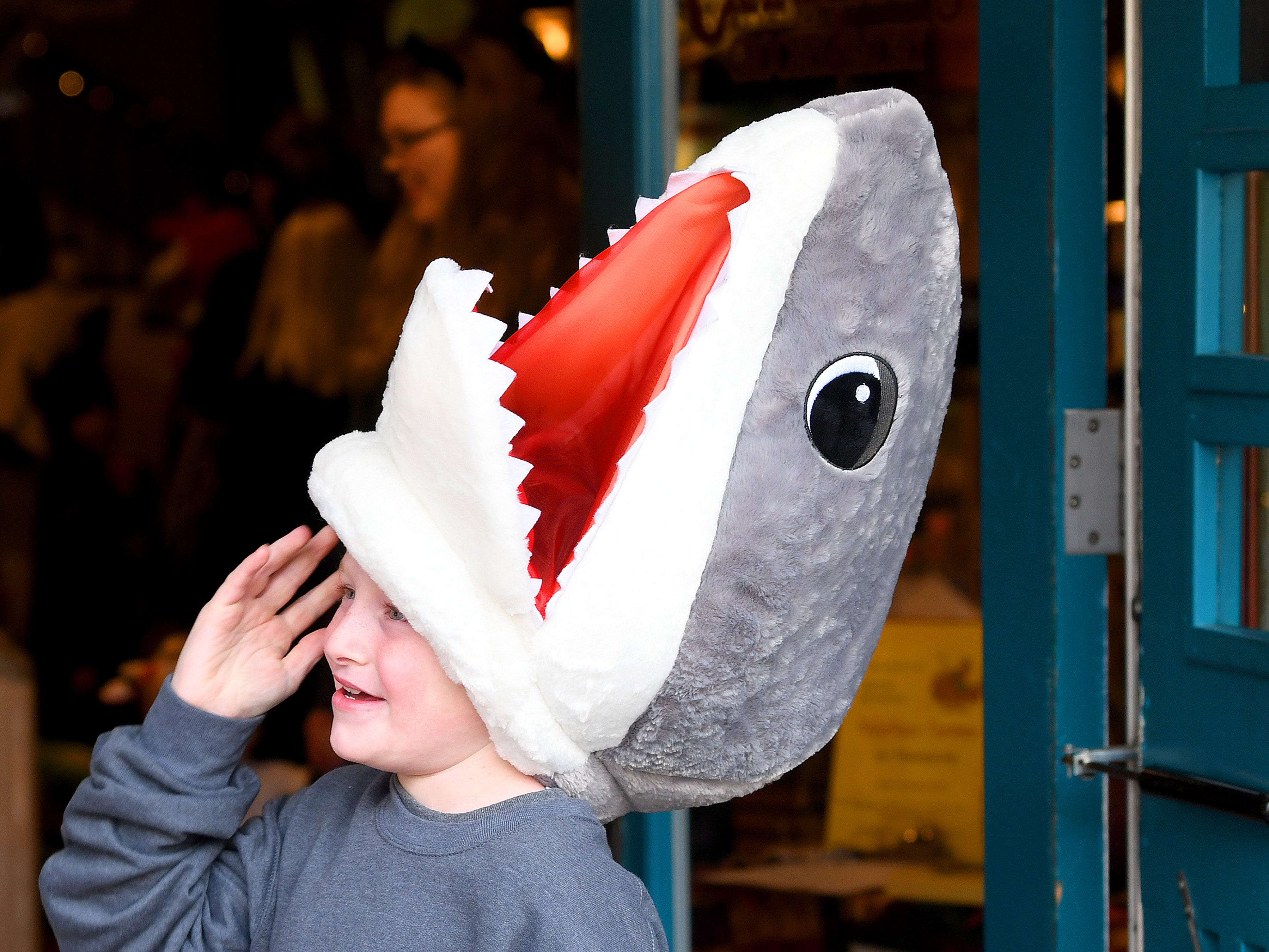 A shark  trick-or-treats in downtown Staunton on Saturday, Oct. 27, 2018.