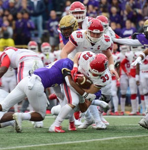 James Madison's Adam Smith brongs down Stony Brook back Donald Liotine during the first half of their Colonial Athletic Association football game at Bridgeforth Stadium in Harrisonburg, Va., on Saturday, Oct. 27