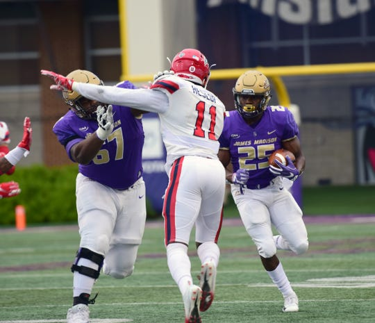 James Madison's Cardon Johnson looks for running room during the first half of the Dukes' Colonial Athletic Association football game against Stony Brook at Bridgeforth Stadium in Harrisonburg, Va., on Saturday, Oct. 27, 2018.