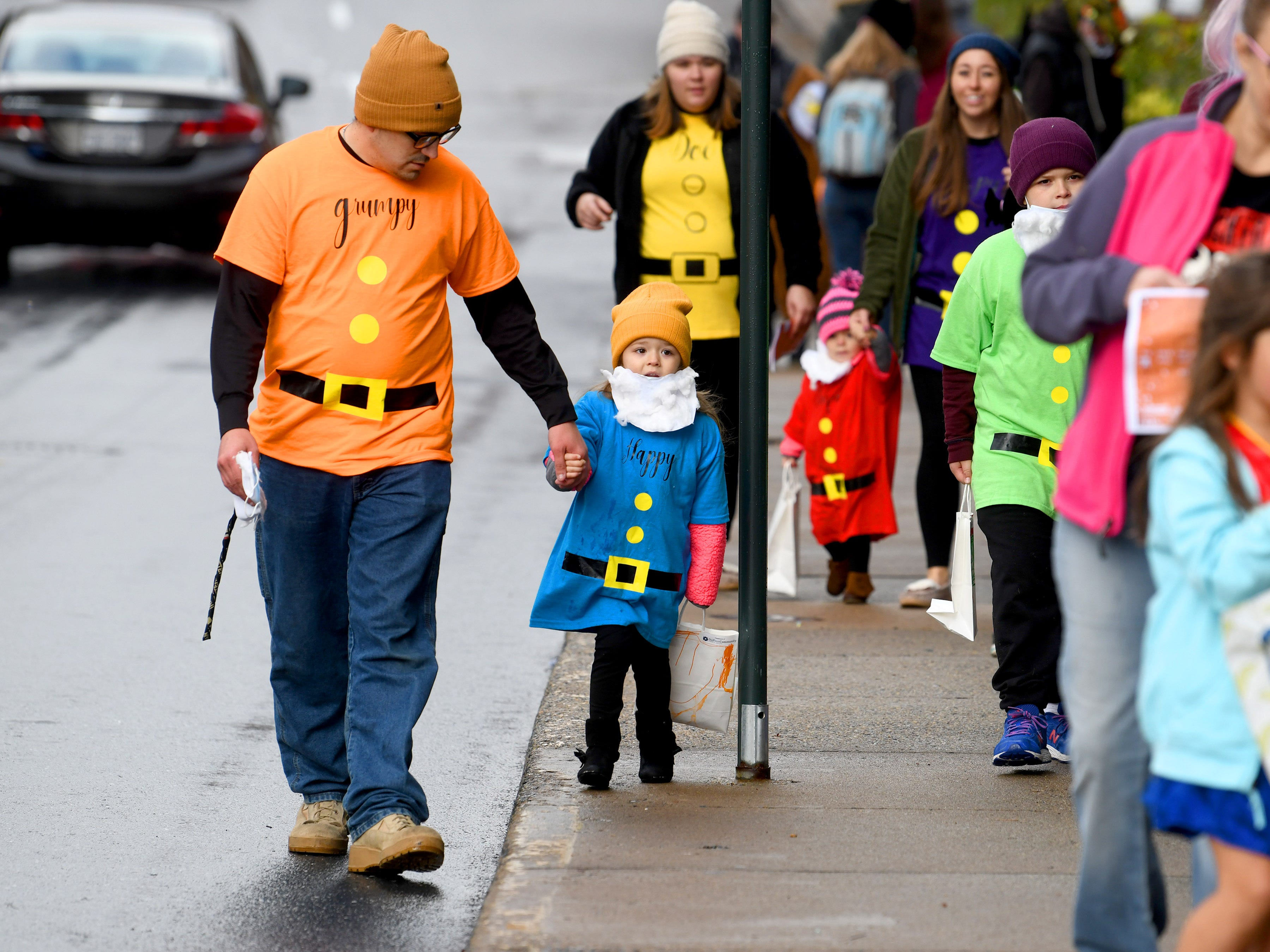 Several of the dwarves from Snow White and the Seven Dwarves trick-or-treat together during the annual downtown trick-or-treating event in Staunton on Saturday, Oct. 27, 2018.