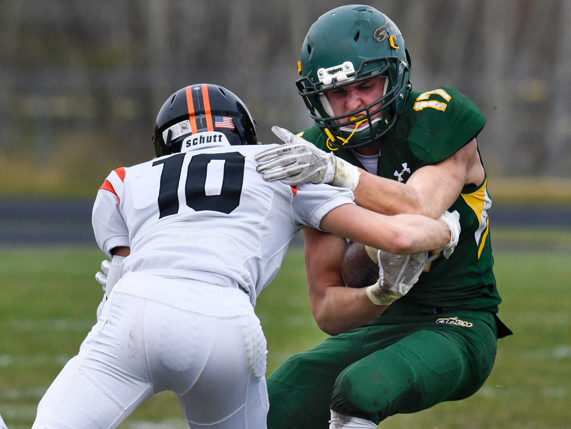 Jake Ackerman carries the ball for Sauk Rapids Saturday, Oct. 27, during the Section 6-5A semifinal game against Tech in Sauk Rapids.
