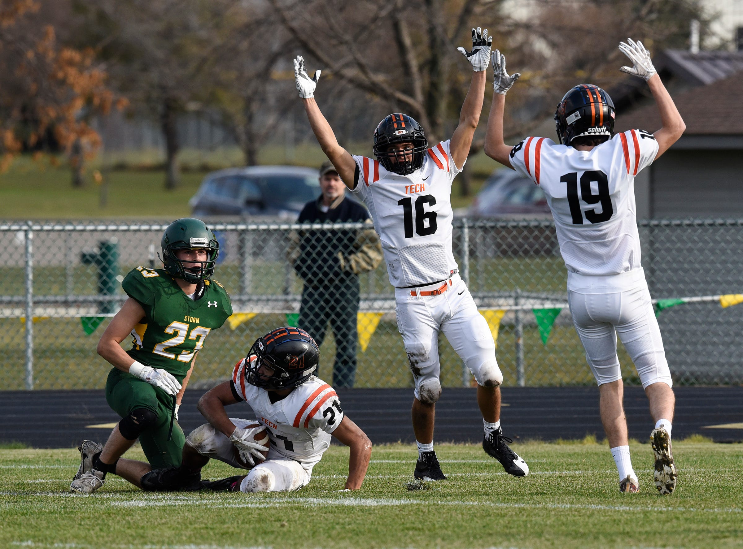 Tech players celebrate a first-half touchdown Saturday, Oct. 27, during the Section 6-5A semifinal game in Sauk Rapids.