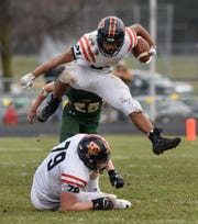 Tech's Kedrik Osuorah leaps for a gain Saturday, Oct. 27, during the Section 6-5A semifinal game in Sauk Rapids.