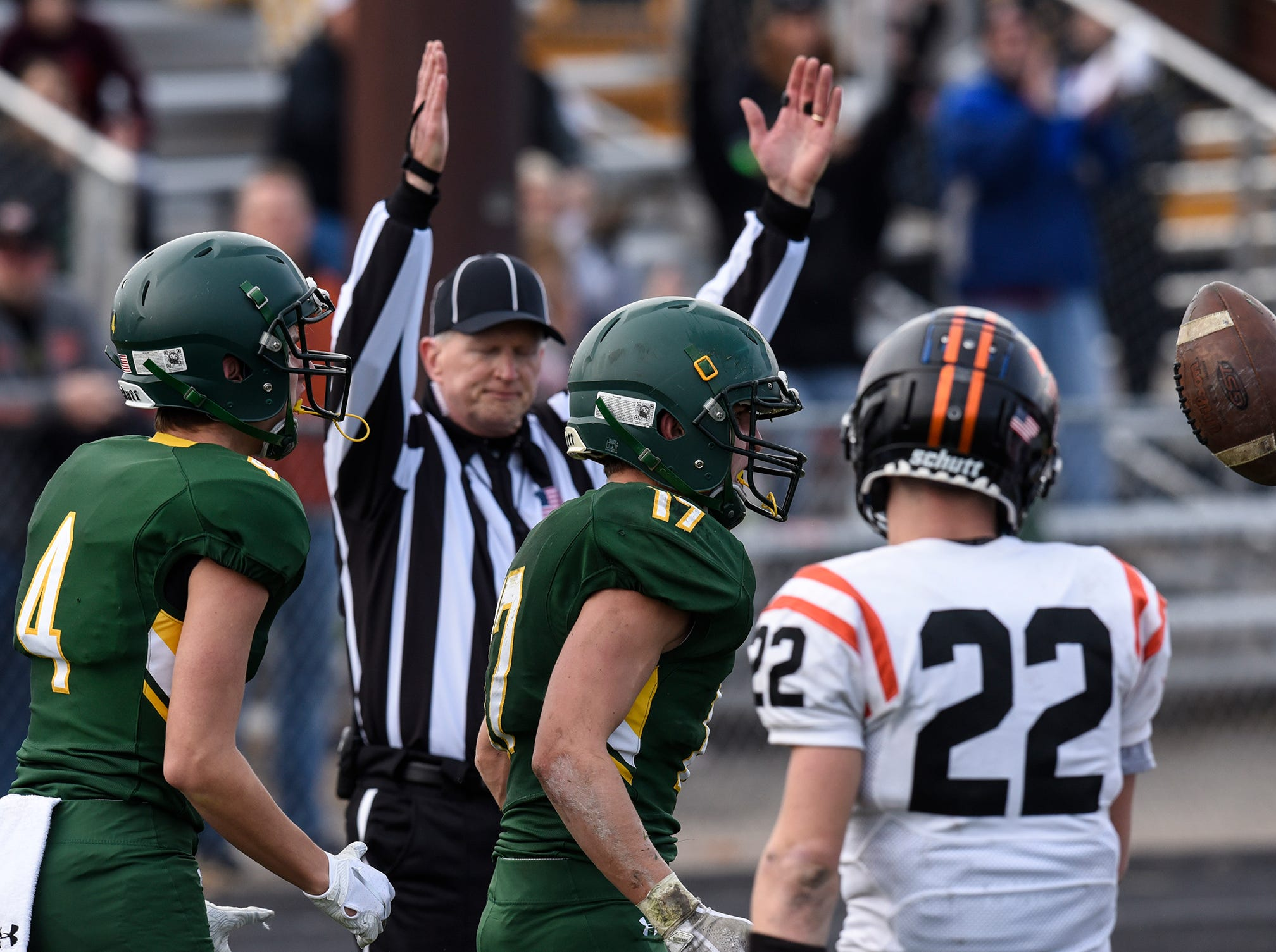 An official signals a Sauk Rapids touchdown Saturday, Oct. 27, during the Section 6-5A semifinal game in Sauk Rapids.