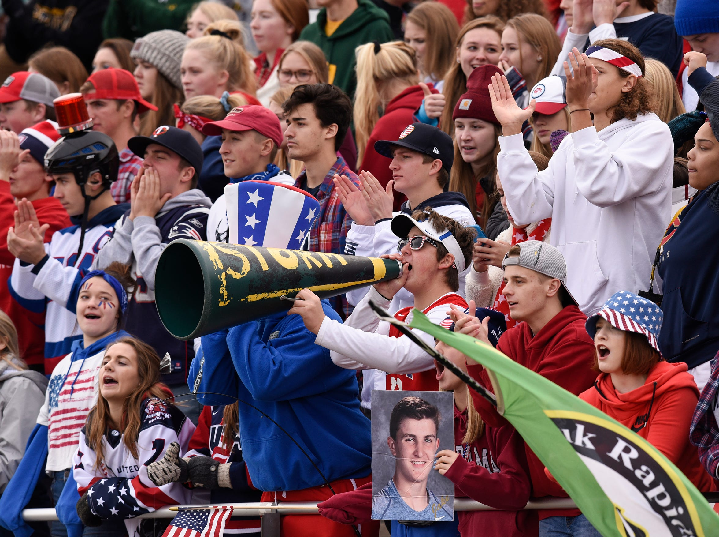 Fans cheer from the Sauk Rapids student section Saturday, Oct. 27, during the Section 6-5A semifinal game in Sauk Rapids.