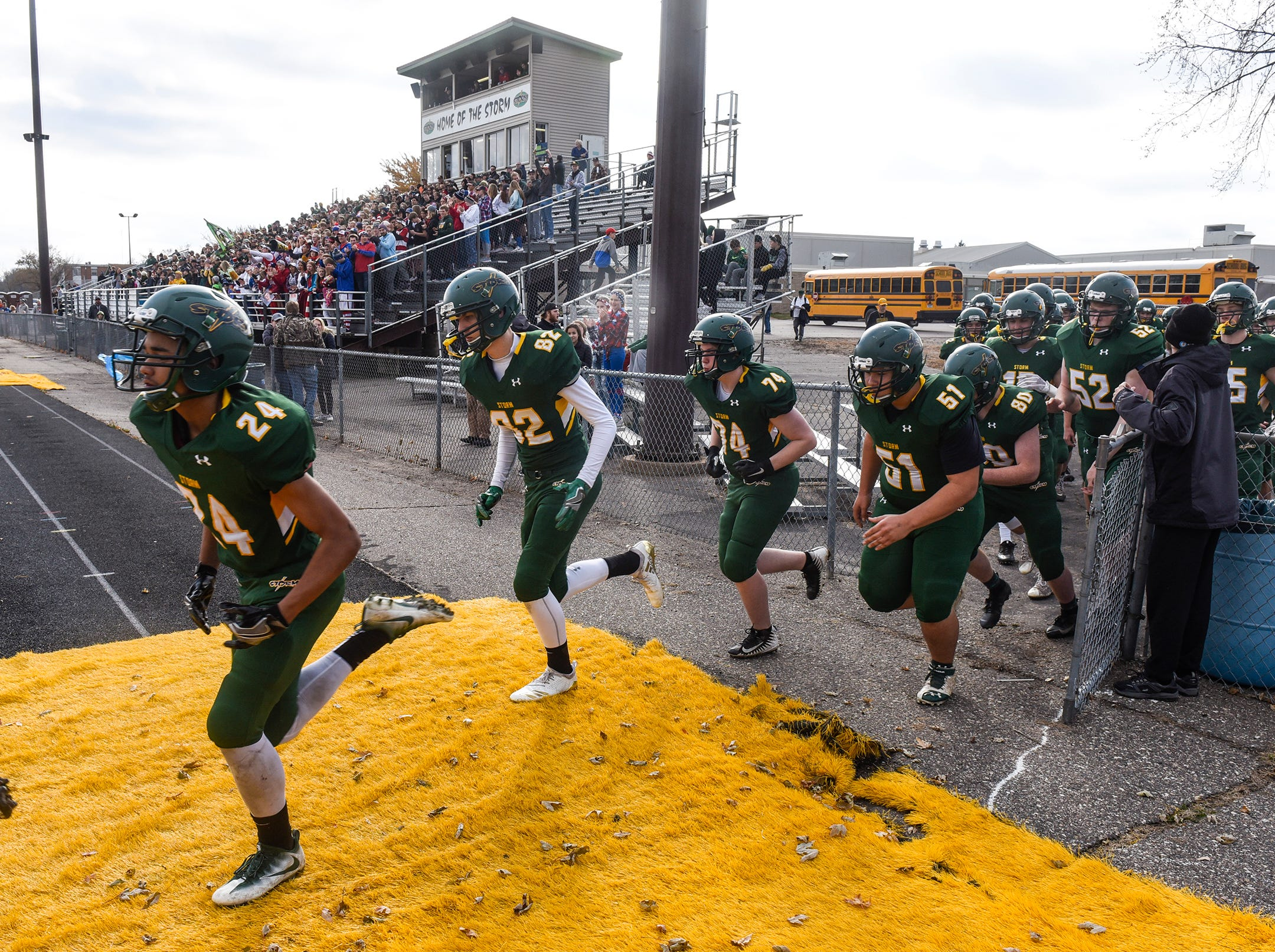 Storm players take the field Saturday, Oct. 27, during the Section 6-5A semifinal game in Sauk Rapids.