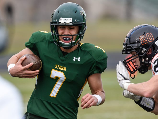 Sauk Rapids quarterback Cade Milton-Baumgardner carries the ball on Saturday, Oct. 27, during a Section 6-5A semifinal game at Sauk Rapids. Milton-Baumgardner is the Times' Football Player of the Year.
