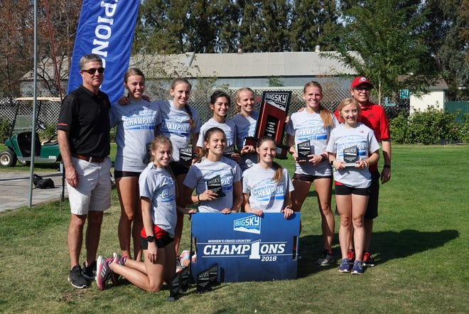 SUU's cross country team poses with the Big Sky championship trophy in Sacramento on Oct. 27, 2018.