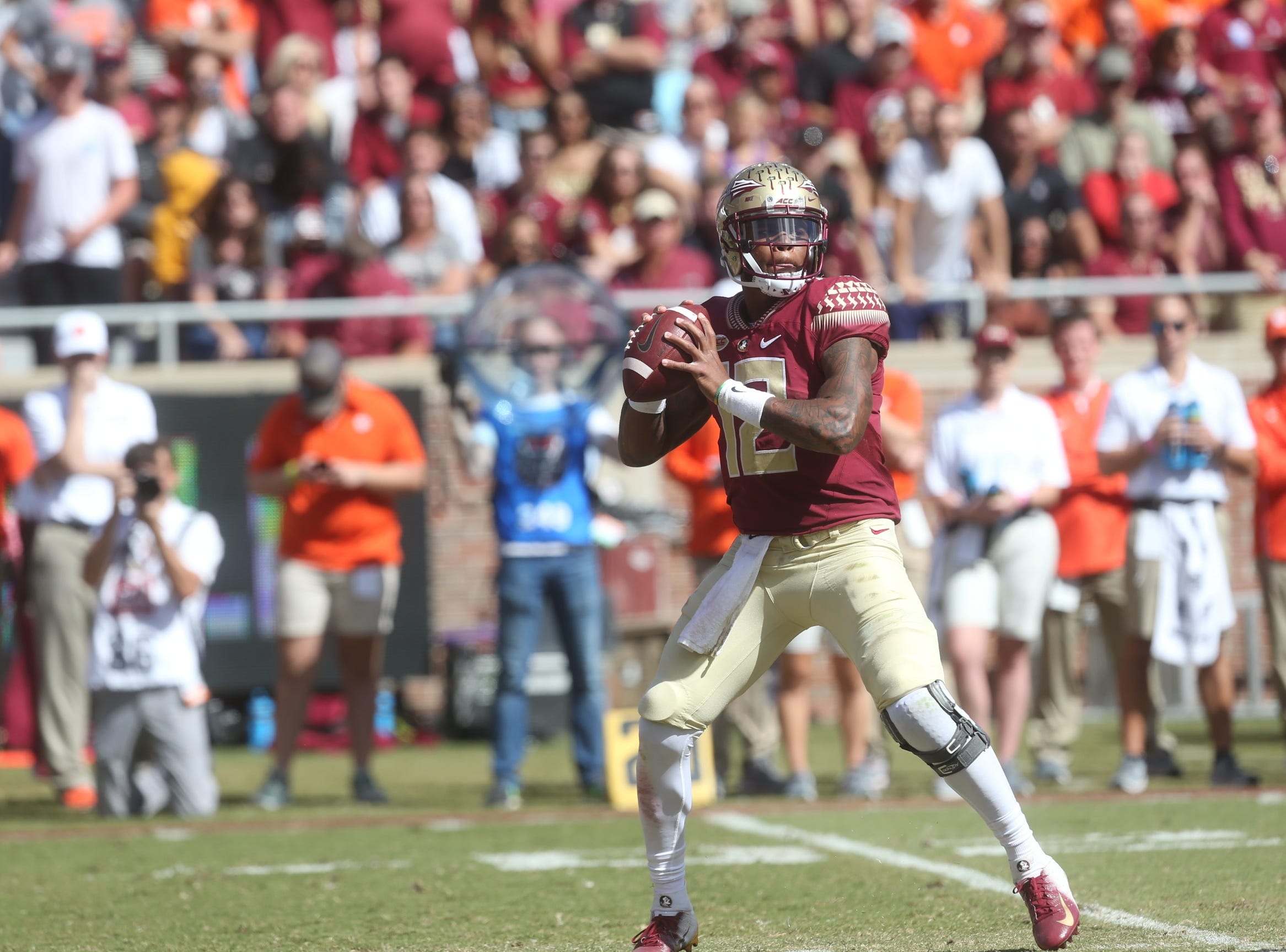 Florida State Seminoles quarterback Deondre Francois (12) looks for an open player to pass to as the Florida State Seminoles take on the Clemson Tigers in college football at Doak Stadium on Saturday, Oct. 27, 2018.