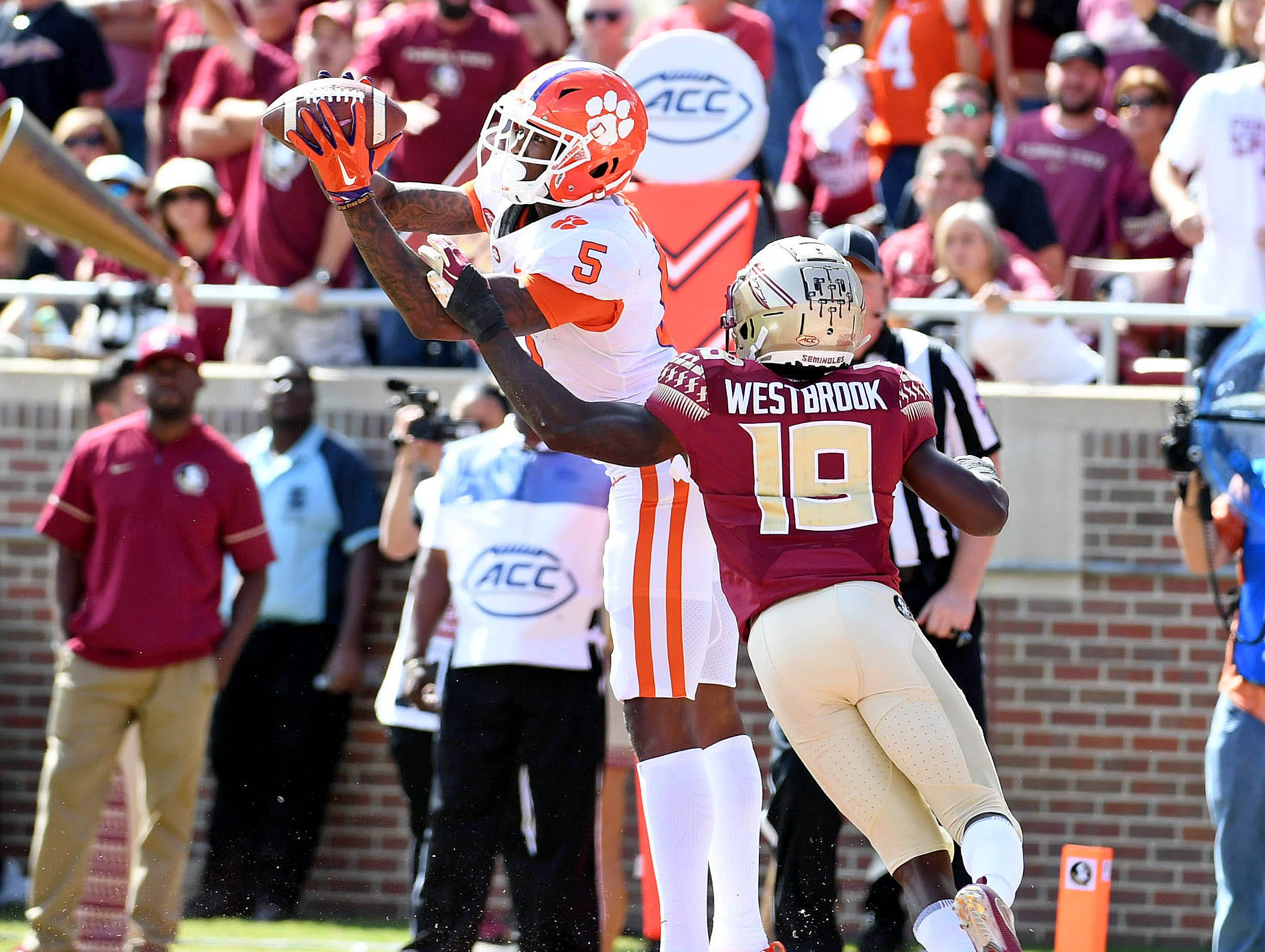 Oct 27, 2018; Tallahassee, FL, USA; Clemson Tigers wide receiver Tee Higgins (5) catches a touchdown past Florida State Seminoles defensive back AJ Westbrook (19) during the first half at Doak Campbell Stadium. Mandatory Credit: Melina Myers-USA TODAY Sports