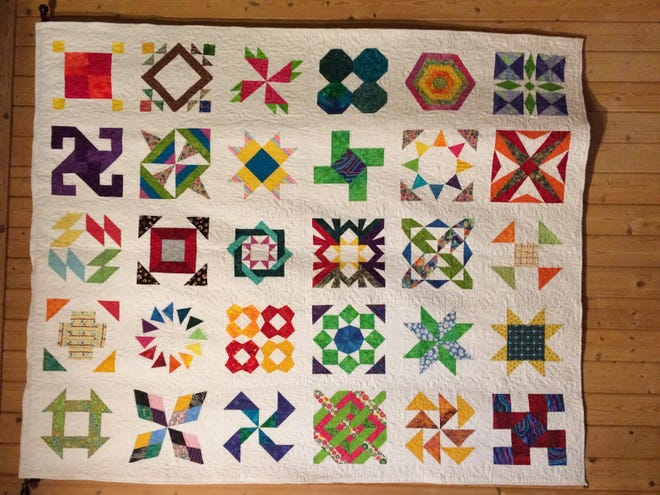 This beautiful quilt made by The Grateful Threads is one of the many artworks at the Artisan Market on NOv. 3.
