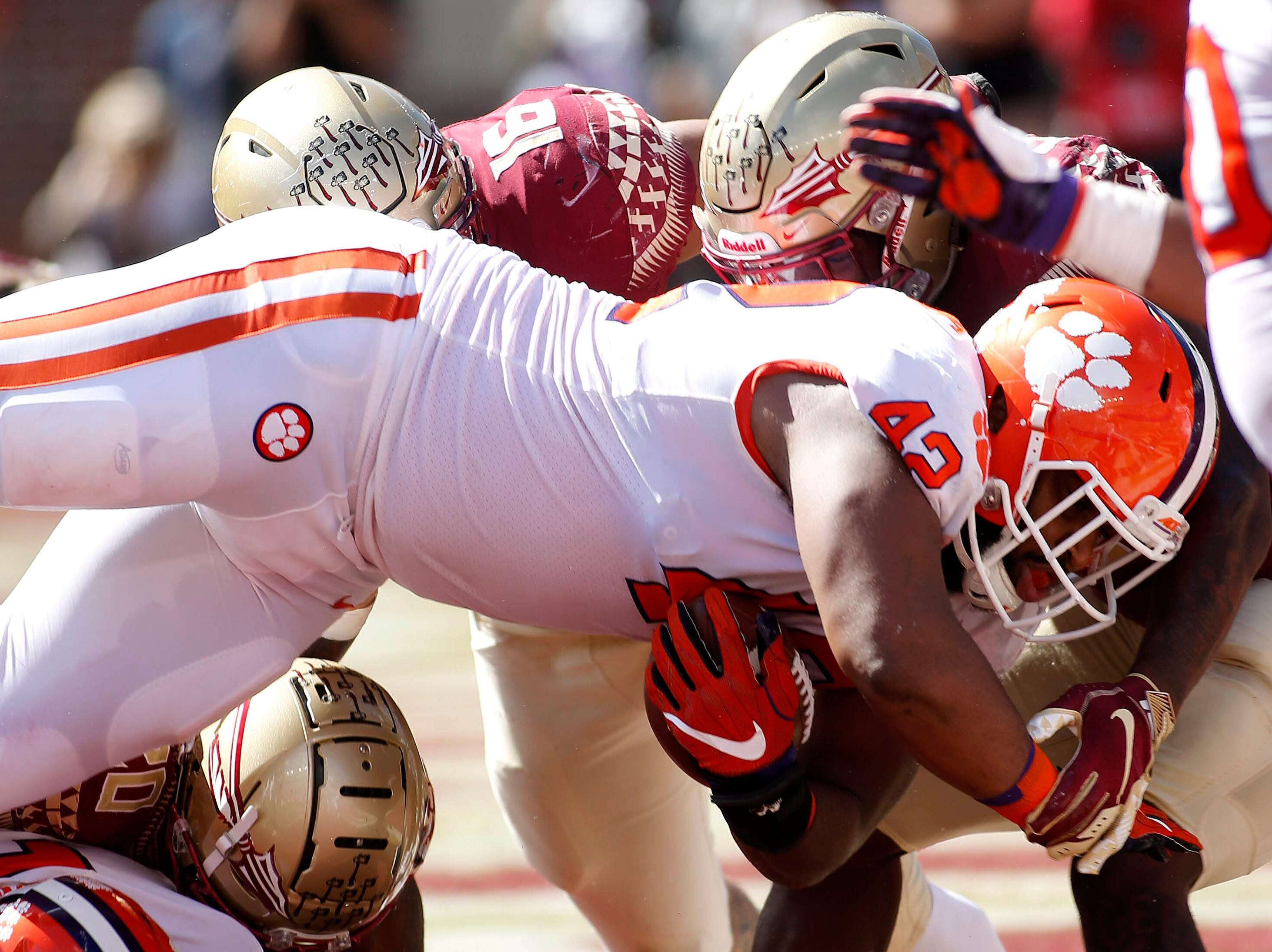 Oct 27, 2018; Tallahassee, FL, USA; Clemson Tigers defensive lineman Christian Wilkins (42) scores a touchdown against the Florida State Seminoles at Doak Campbell Stadium during the second quarter of play.