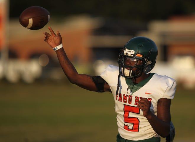 FAMU DRS quarterback Daryl Wilson throws a pass during pre-game warmups.