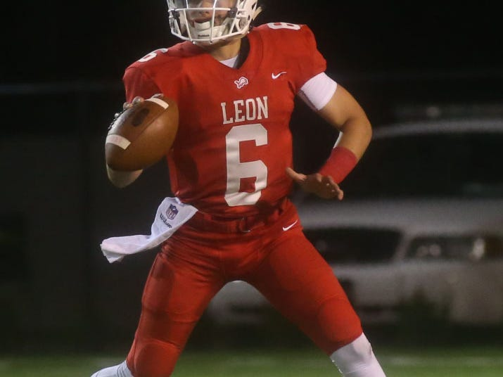 Leon High School quarterback Paxton Tomaini (6) looks to pass as the Leon lions face off against the Chiles timberwolves in high school football at Gene Cox Stadium on Friday, Oct. 26, 2018.