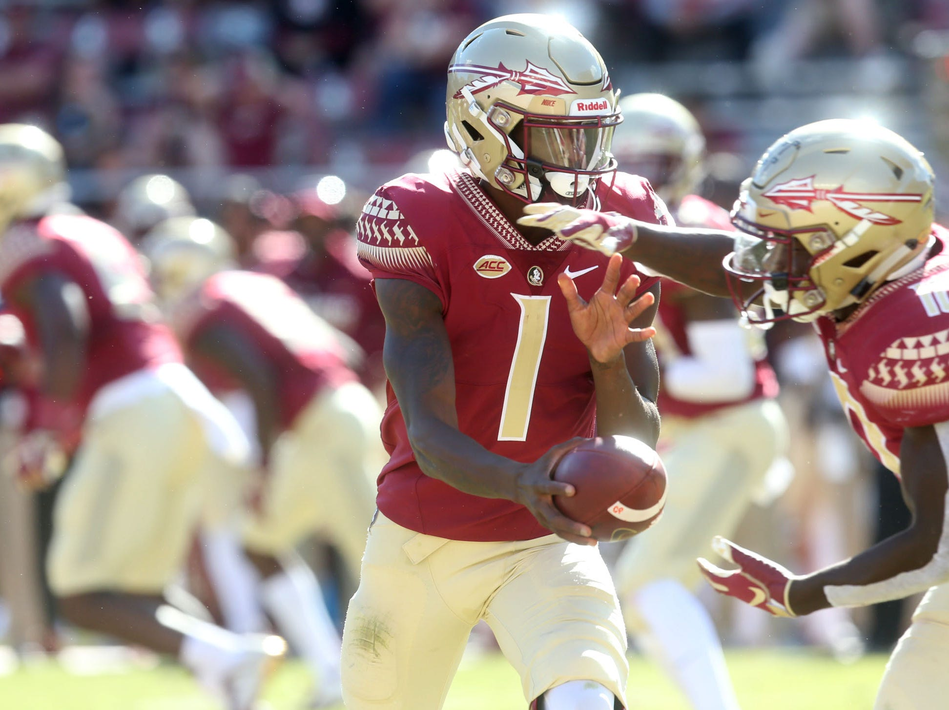 Florida State Seminoles quarterback James Blackman (1) makes a hand off as the Florida State Seminoles take on the Clemson Tigers in college football at Doak S. Campbell Stadium on Saturday, Oct. 27, 2018.
