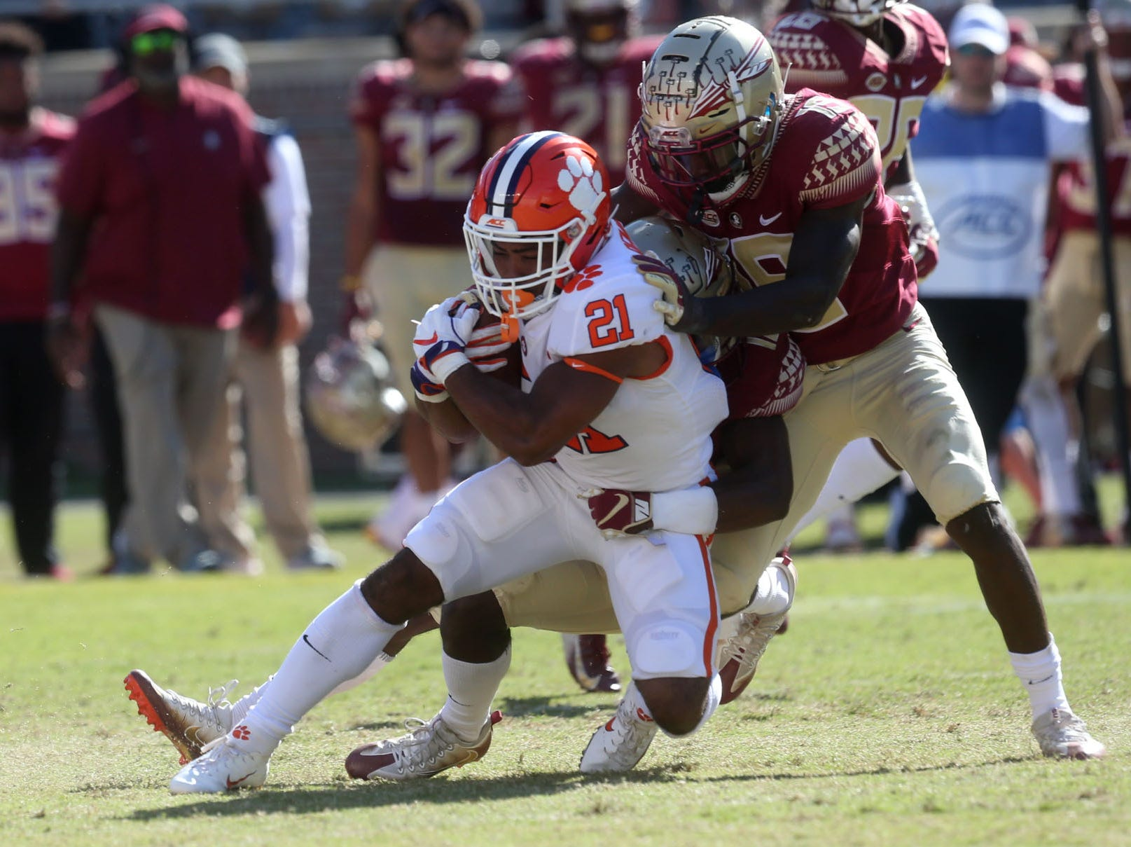 Florida State Seminoles defensive back A.J. Lytton (12) tackles Clemson Tigers running back Darien Rencher (21) as the Florida State Seminoles take on the Clemson Tigers in college football at Doak S. Campbell Stadium on Saturday, Oct. 27, 2018.