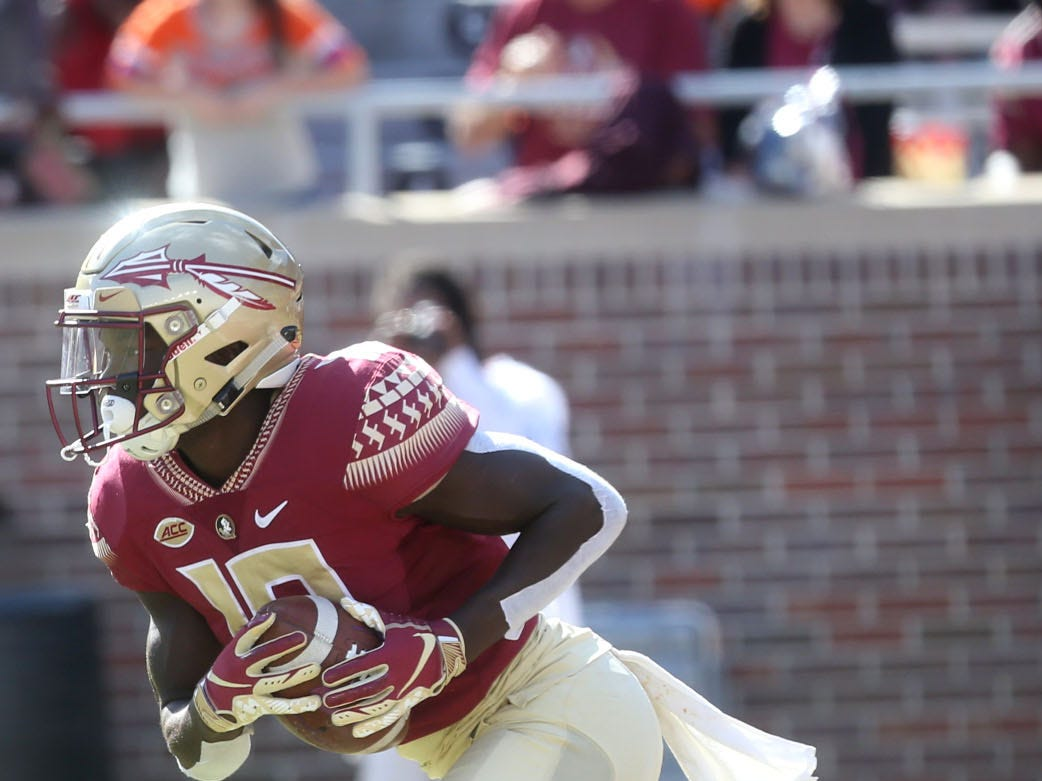 Florida State Seminoles running back Anthony Grant (10) runs the ball as the Florida State Seminoles take on the Clemson Tigers in college football at Doak S. Campbell Stadium on Saturday, Oct. 27, 2018.